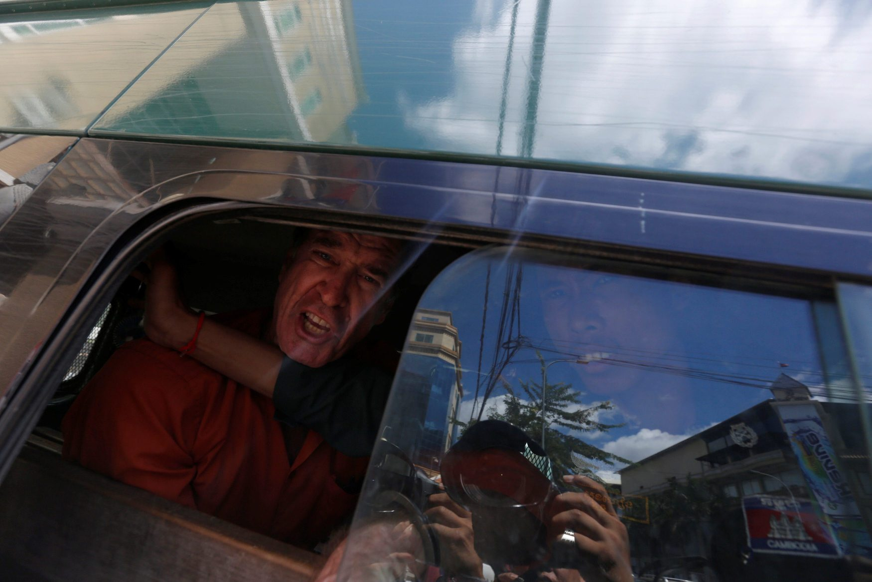 Australian filmmaker James Ricketson shouts inside a prison truck as he leaves the Municipal Court of Phnom Penh, Cambodia, August 31, 2018. REUTERS/Samrang Pring