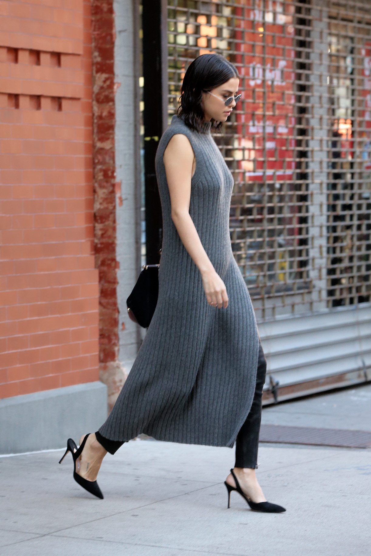 EXCLUSIVE: Singer Selena Gomez, wearing a full-length grey sweater dress, black leather pants and slingback pumps, is spotted leaving her apartment in New York City, New York, USA.  Pictured: Selena Gomez Ref: SPL1606953 221017 EXCLUSIVE Picture by: SplashNews.com  Splash News and Pictures Los Angeles: 310-821-2666 New York: 212-619-2666 London: 0207 644 7656 Milan: +39 02 4399 8577 Sydney: +61 02 9240 7700 photodesk@splashnews.com  World Rights