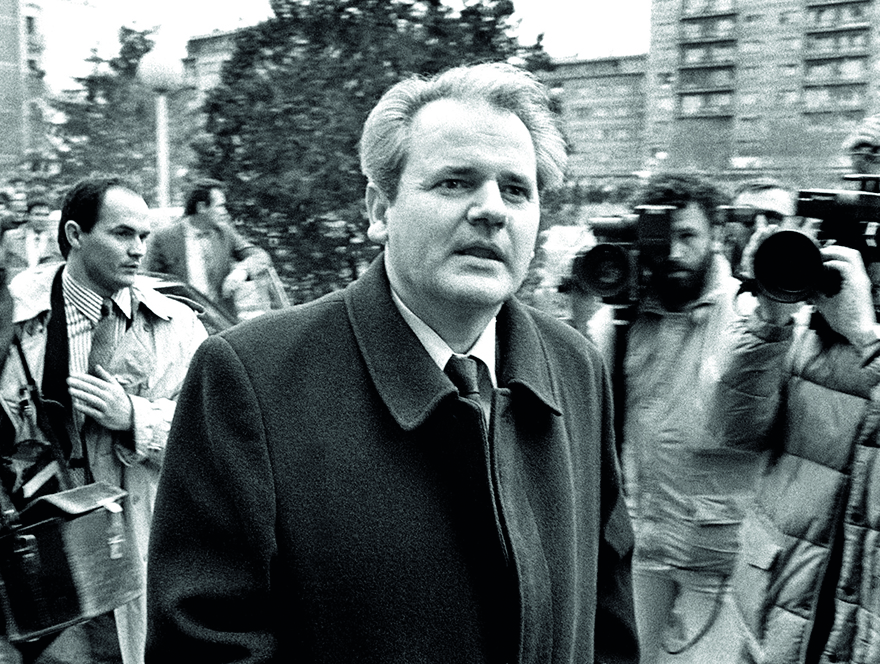 -FILE PHOTO DEC88- Former Yugoslav President Slobodan Milosevic arrives in Pristina, the capital of Serbia's province of Kosovo, to meet Trepca mine complex workers on strike over constitutional changes that suspended the autonomy of Kosovo, in this December 1988 file photo. [The U.N. war crimes tribunal hopes an autopsy on Milosevic on March 12, 2006 will clear up the cause of his death in his cell only months before a verdict was due in his four-year-old trial. Milosevic, branded the