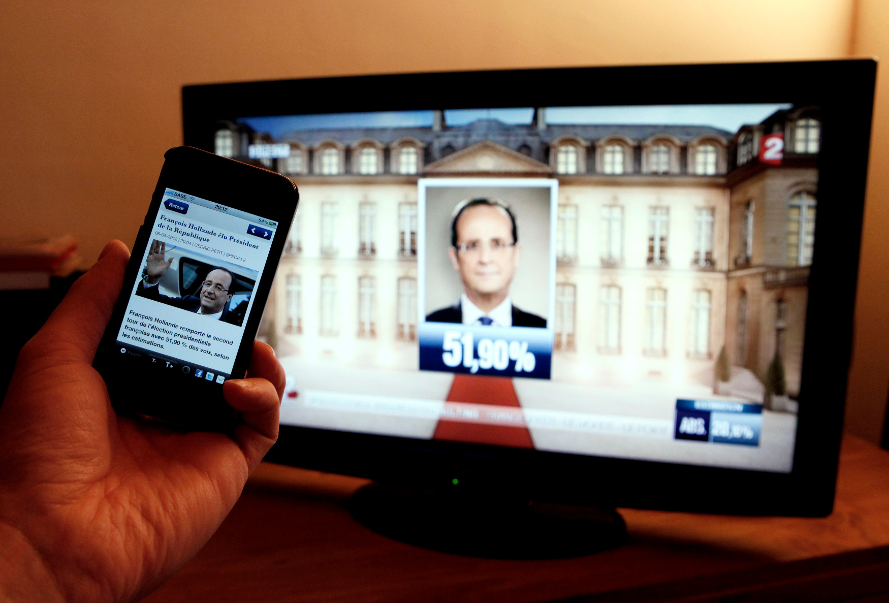 France national television France 2 announces France's Socialist party candidate Francois Hollande as the winner of the second round 2012 French presidential election in this photo illustration  taken in Wavre, May 6, 2012. France voted in elections on Sunday and Francois Hollande becomes the nation's first Socialist president  in 17 years, early estimations said. REUTERS/Sebastien Pirlet    (BELGIUM - Tags: POLITICS ELECTIONS) - PM1E8561LF701