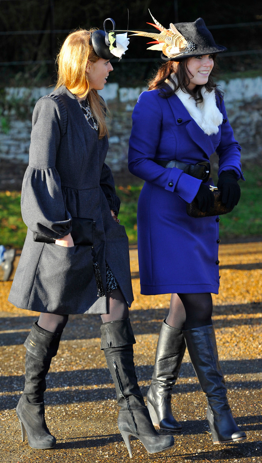 Britain's Princess Eugenie (R) and Princess Beatrice (L) leave after a Christmas Day service at St Mary Magdalene Church on the Royal estate at Sandringham, Norfolk, in east England, December 25, 2010.  REUTERS/Toby Melville (BRITAIN - Tags: RELIGION ROYALS SOCIETY) - GM1E6CP1PO801