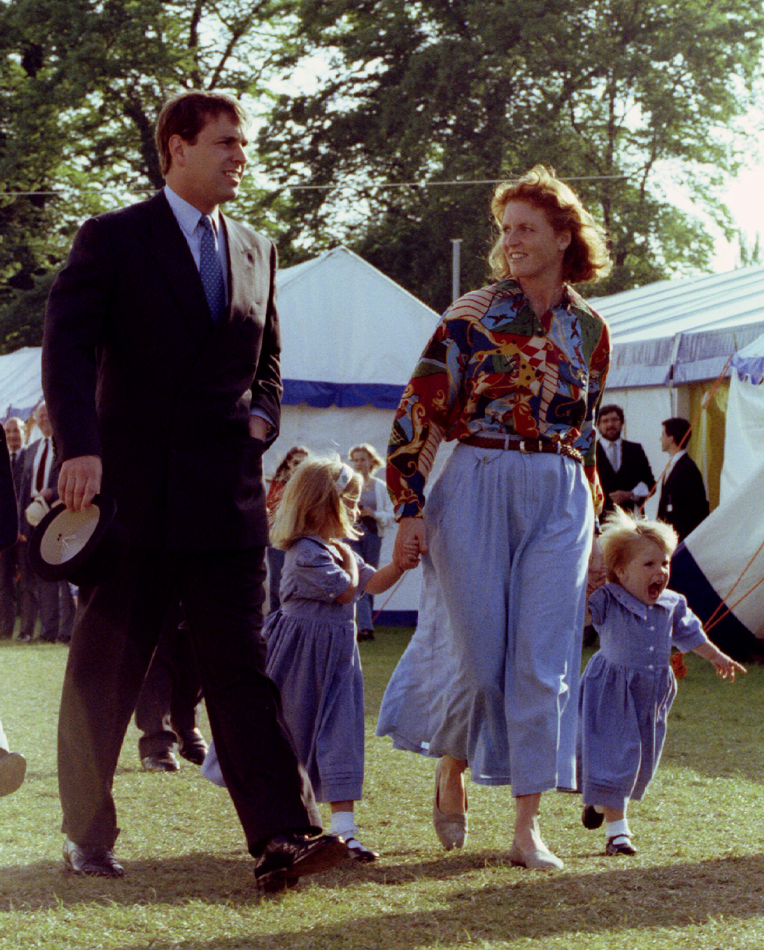 The Duke and Duchess of York with their children Princess Beatrice (c) and Eugenie during the Royal Windsor Horse show last year (May 16 1992) . Buckingham Palace today announced the couple's formal seperation June 28. - PBEAHUNIVDQ