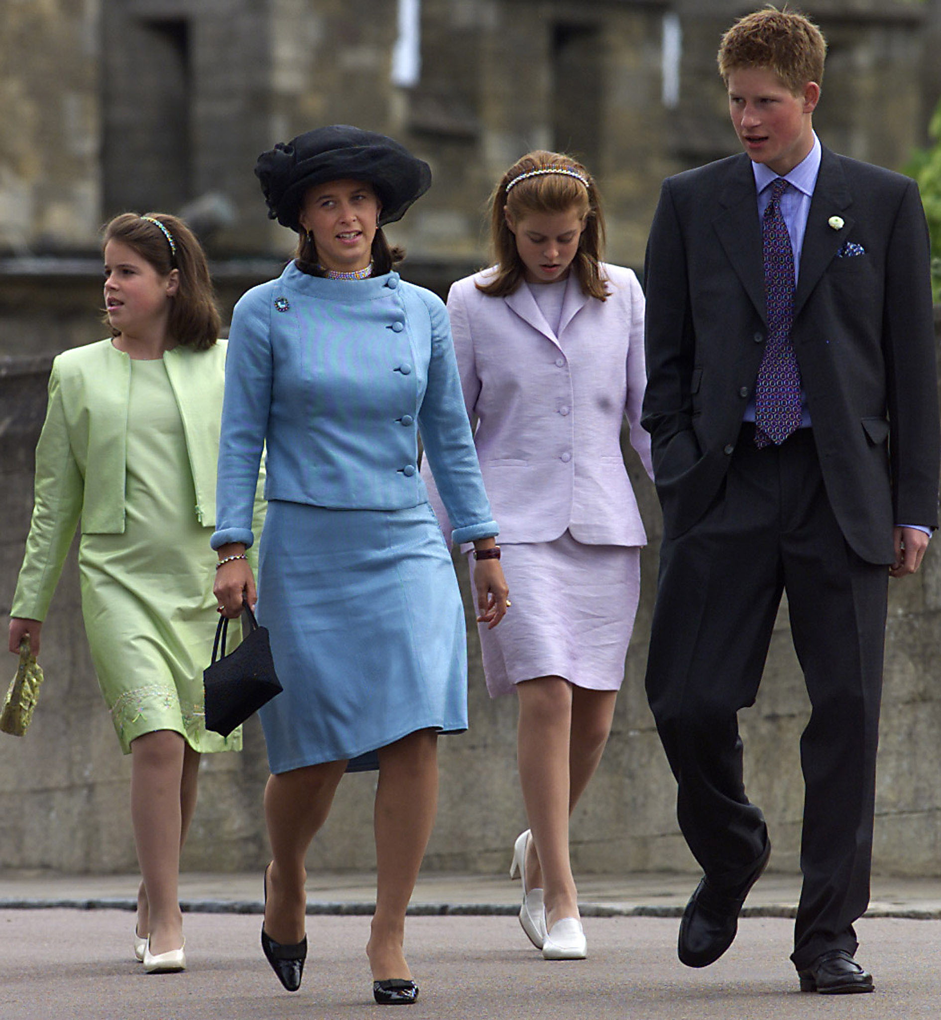 Prince Harry (R) arrives at the chapel in Windsor Castle with (L to R) Princess Eugenie, Xenia Hohenlohe-Langenburg and Princess Beatrice, June 10, 2001. [Harry was joined by many members of the royal family to celebrate the 80th birthday of his grandfather Prince Philip, the Duke of Edinburgh.   ] - PBEAHULAMBD