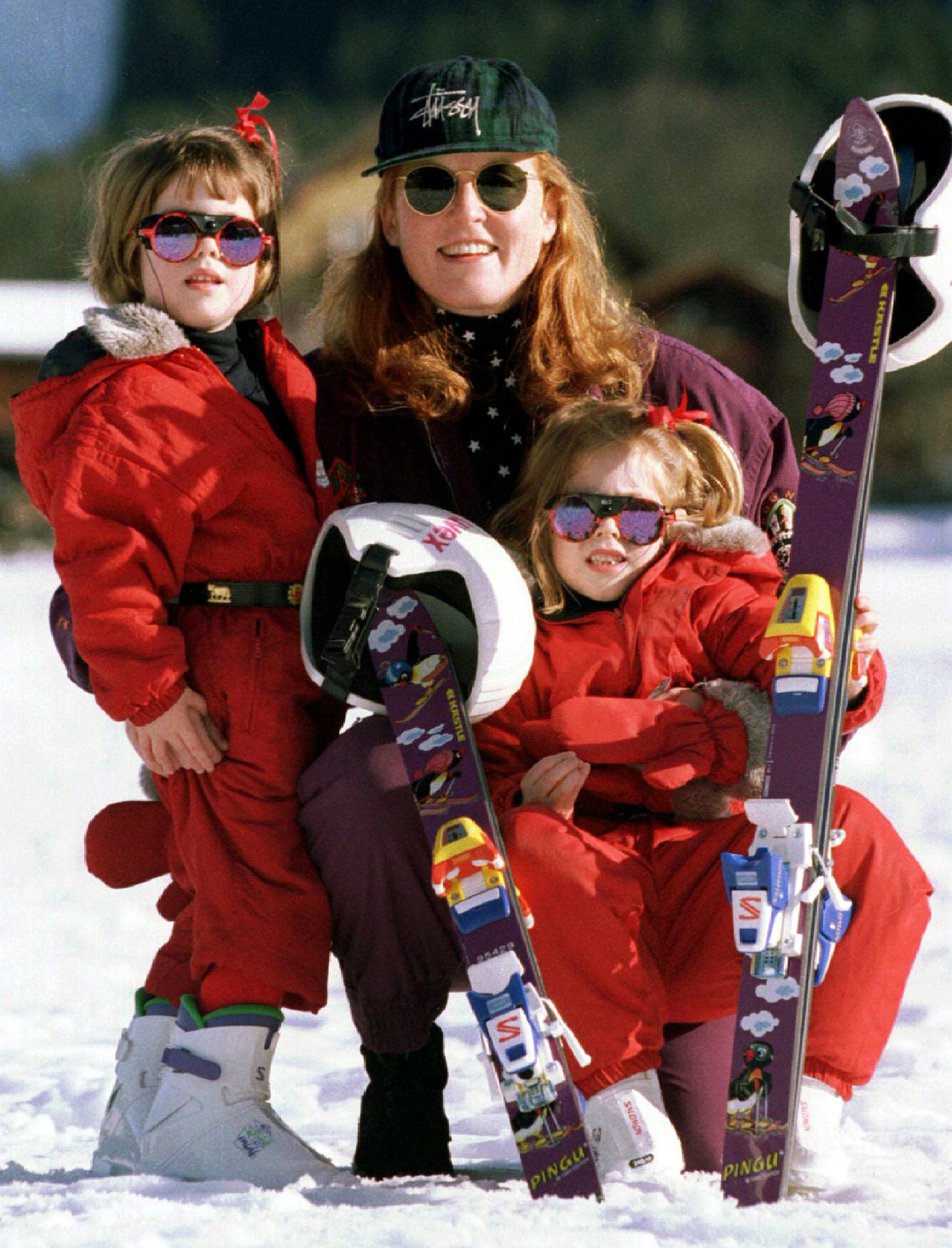 Princesses Eugenie (R) and Beatrice pose for photographers with their mother the Duchess of York Sarah Ferguson in Klosters Dec 29 - PBEAHUNIUEH