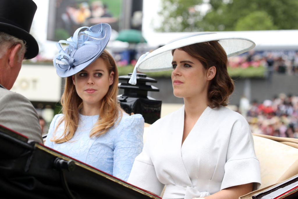 ASCOT, ENGLAND - JUNE 19:  Prince Charles, Prince of Wales (L), Princess Beatrice of York (C) and Princess Eugenie of York attend Royal Ascot Day 1 at Ascot Racecourse on June 19, 2018 in Ascot, United Kingdom.  (Photo by Chris Jackson/Getty Images)