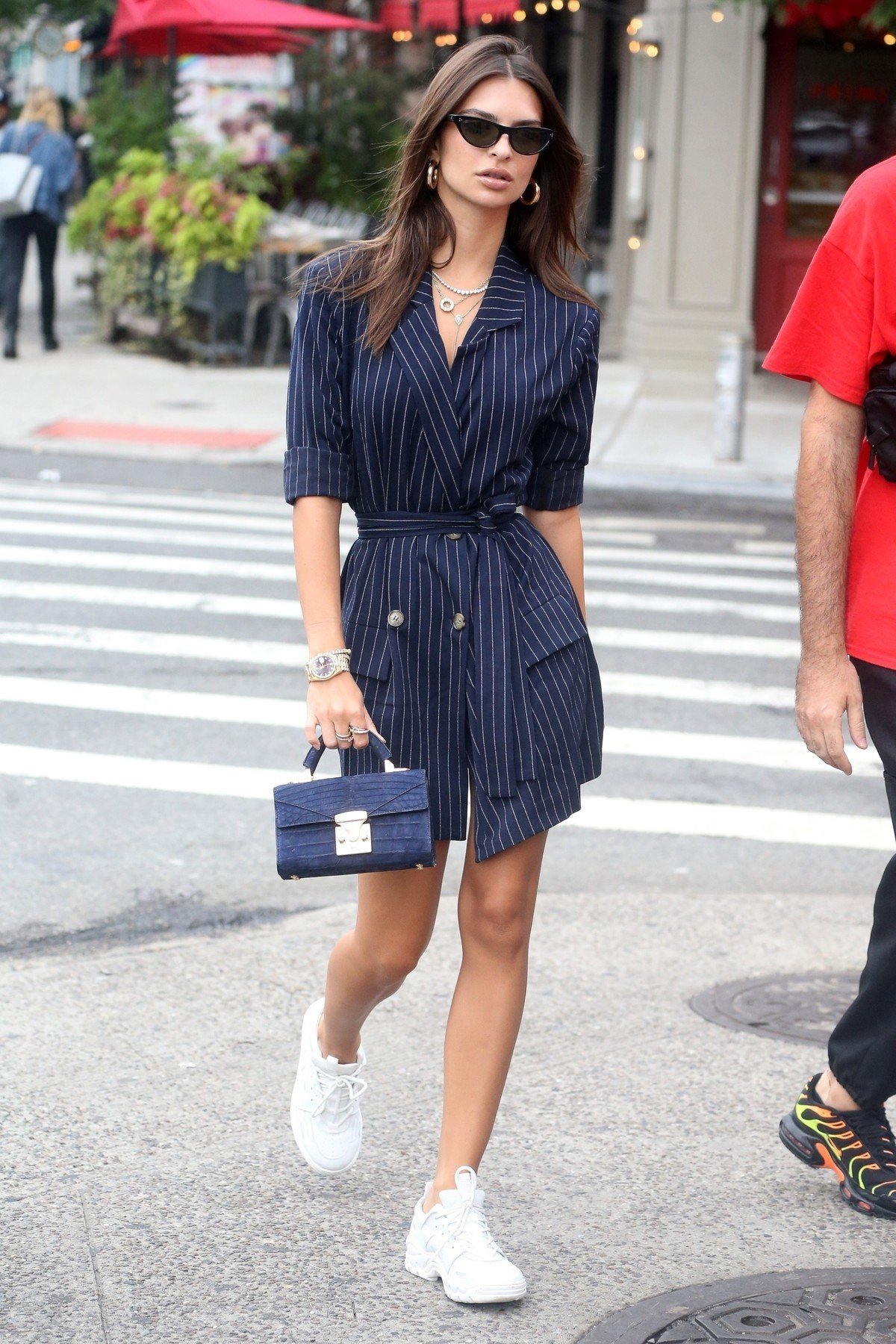New York, NY  - Emily Ratajkowski sports a navy blue, menswear-inspired, pinstriped shirt dress while out in New York. The model accessorized her outfit with a tiny blue purse.  Pictured: Emily Ratajkowski    *UK Clients - Pictures Containing Children Please Pixelate Face Prior To Publication*, Image: 386310776, License: Rights-managed, Restrictions: , Model Release: no, Credit line: Profimedia, AKM-GSI