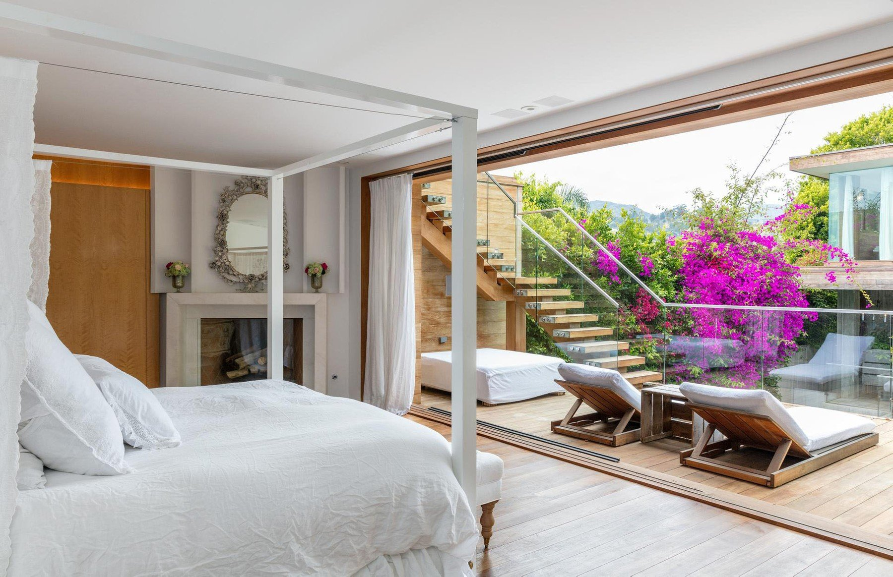 One-time 'Baywatch' babe Pamela Anderson has put her Malibu home up for lease at ,000-a-month.  The blonde bombshell has owned the Malibu Colony property for more than a decade and tried to sell it about five years ago. It's two structures separated by a swimming pool. The 5,500 square foot property has been designed by architect Philip Vertoch. The interior was designed by Pamela and interior designer Josh Chryssanthou. Inside there's a chef's kitchen and the master bedroom suite has its own fireplace and soaking tub and a patio that overlooks the pool. Including the guesthouse, which has its own hot tub and custom fire pit, there are four bedrooms and three bathrooms., Image: 386667530, License: Rights-managed, Restrictions: , Model Release: no, Credit line: Profimedia, IMP Features