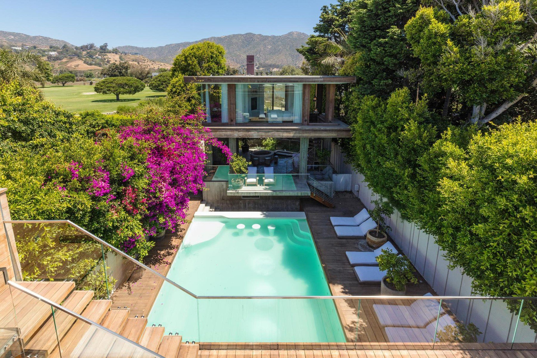 One-time 'Baywatch' babe Pamela Anderson has put her Malibu home up for lease at ,000-a-month.  The blonde bombshell has owned the Malibu Colony property for more than a decade and tried to sell it about five years ago. It's two structures separated by a swimming pool. The 5,500 square foot property has been designed by architect Philip Vertoch. The interior was designed by Pamela and interior designer Josh Chryssanthou. Inside there's a chef's kitchen and the master bedroom suite has its own fireplace and soaking tub and a patio that overlooks the pool. Including the guesthouse, which has its own hot tub and custom fire pit, there are four bedrooms and three bathrooms., Image: 386667555, License: Rights-managed, Restrictions: , Model Release: no, Credit line: Profimedia, IMP Features