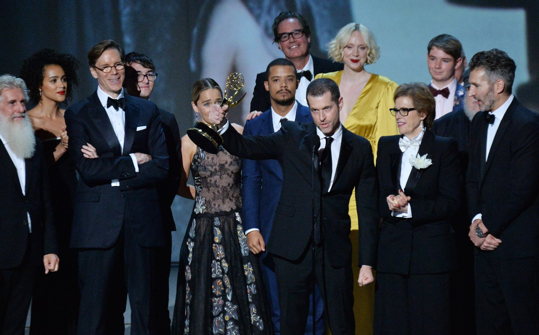 Writer-producers D.B. Weiss (C) and David Benioff (R) and the cast of