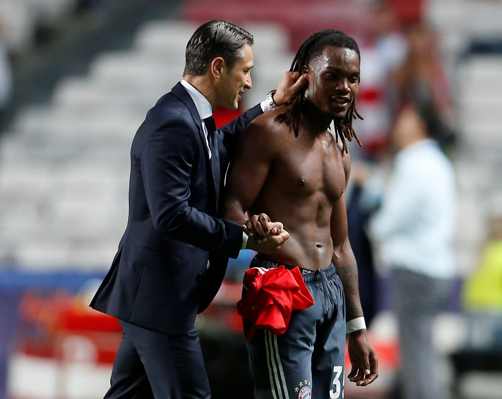 Soccer Football - Champions League - Group Stage - Group E - Benfica v Bayern Munich - Estadio da Luz, Lisbon, Portugal - September 19, 2018  Bayern Munich coach Niko Kovac with Renato Sanches at the end of the match   REUTERS/Pedro Nunes