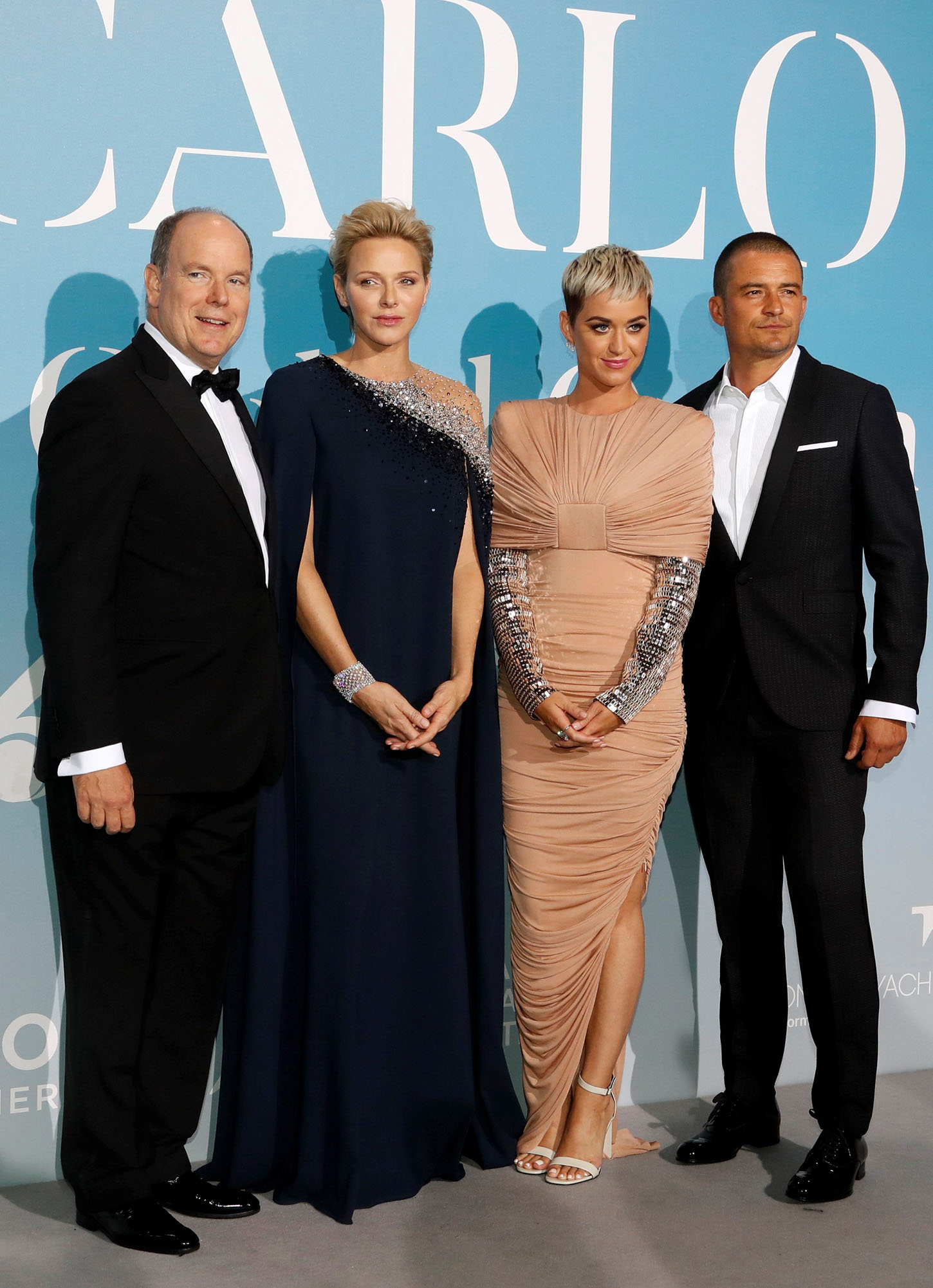 Monaco's Prince Albert II and Princess Charlene pose with singer Katy Perry and British actor Orlando Bloom upon their arrival for the Monte-Carlo Gala for the Global Ocean in Monaco, September 26, 2018. REUTERS/Eric Gaillard