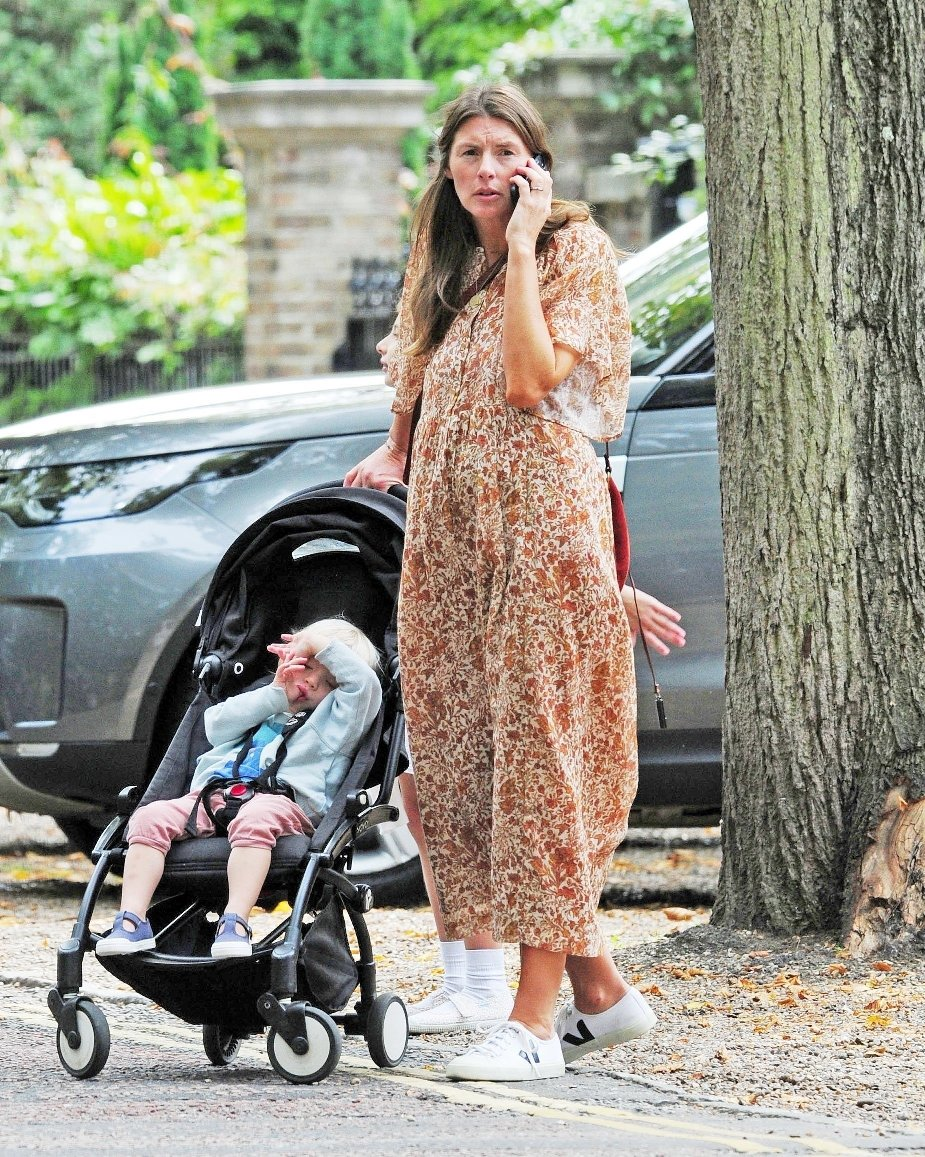 BGUK_1325907 - London, UNITED KINGDOM  - *EXCLUSIVE*  - Jamie Oliver's wife Jools Oliver pictured out and about in Highgate, London checking her phone. Jools wore a flower pattern dress with white trainers while out and about with her kids.  Pictured: Jools Oliver  BACKGRID UK 3 SEPTEMBER 2018, Image: 385209457, License: Rights-managed, Restrictions: , Model Release: no, Credit line: Profimedia, Xposurephotos