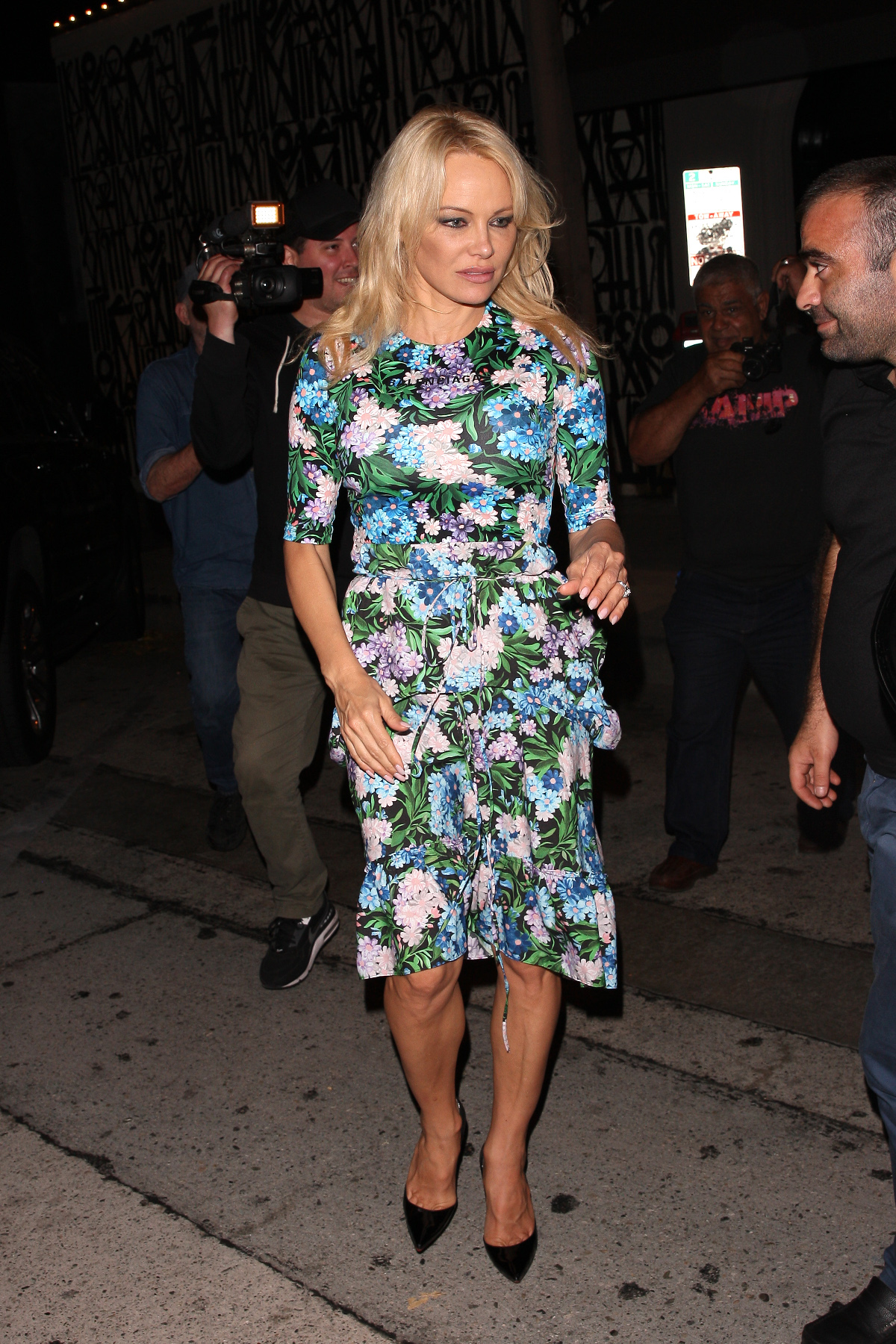 French world cup champion Adil Rami and his girlfriend Pamela Anderson are seen heading to Craig's restaurant for a romantic dinner date in West Hollywood. The couple arrived together at 10 P.M. and walked in separately. They left at 11:30 P.M. together. Pamela is wearing a beautiful floral dress. Adil is wearing ripped jeans. Onlookers inside the restaurant said that the couple were very affectionate and couldn't stop staring at each other.  Pictured: Adil Rami and Pamela Anderson Ref: SPL5011984 240718 NON-EXCLUSIVE Picture by: Photographer Group / SplashNews.com  Splash News and Pictures Los Angeles: 310-821-2666 New York: 212-619-2666 London: 0207 644 7656 Milan: +39 02 4399 8577 Sydney: +61 02 9240 7700 photodesk@splashnews.com  World Rights