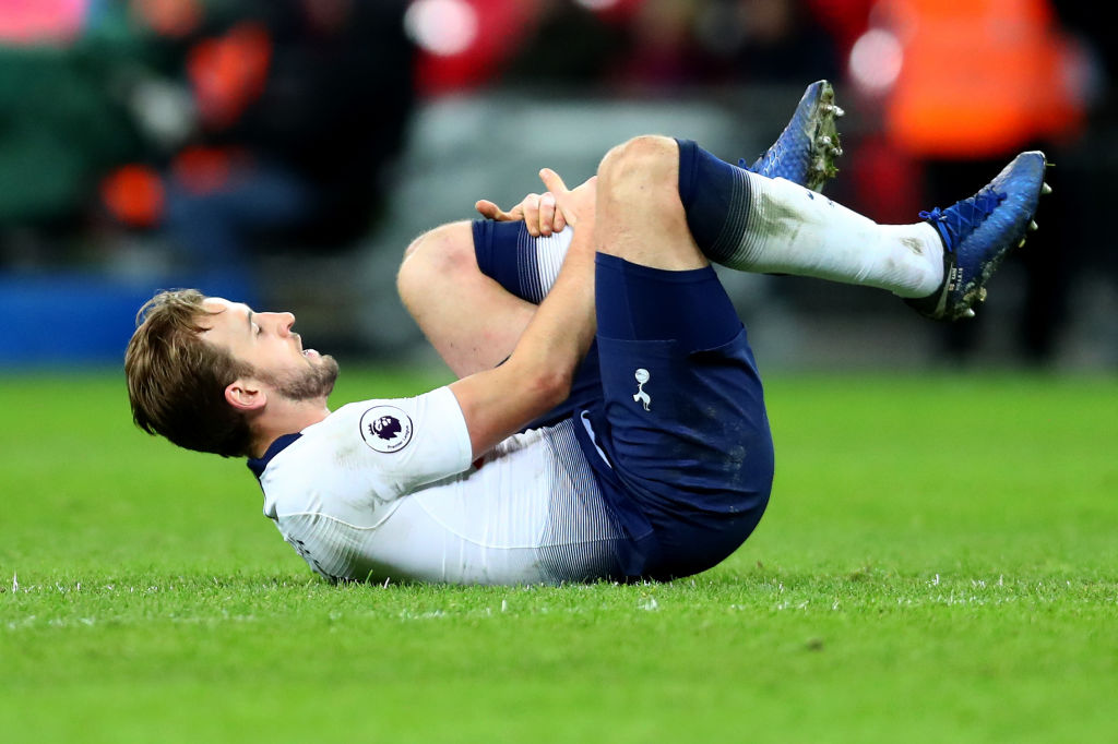 LONDON, ENGLAND - JANUARY 13: Harry Kane of Tottenham Hotspur holds his leg after a heavy challenge in the final moments of the Premier League match between Tottenham Hotspur and Manchester United at Wembley Stadium on January 13, 2019 in London, United Kingdom. (Photo by Clive Rose/Getty Images)