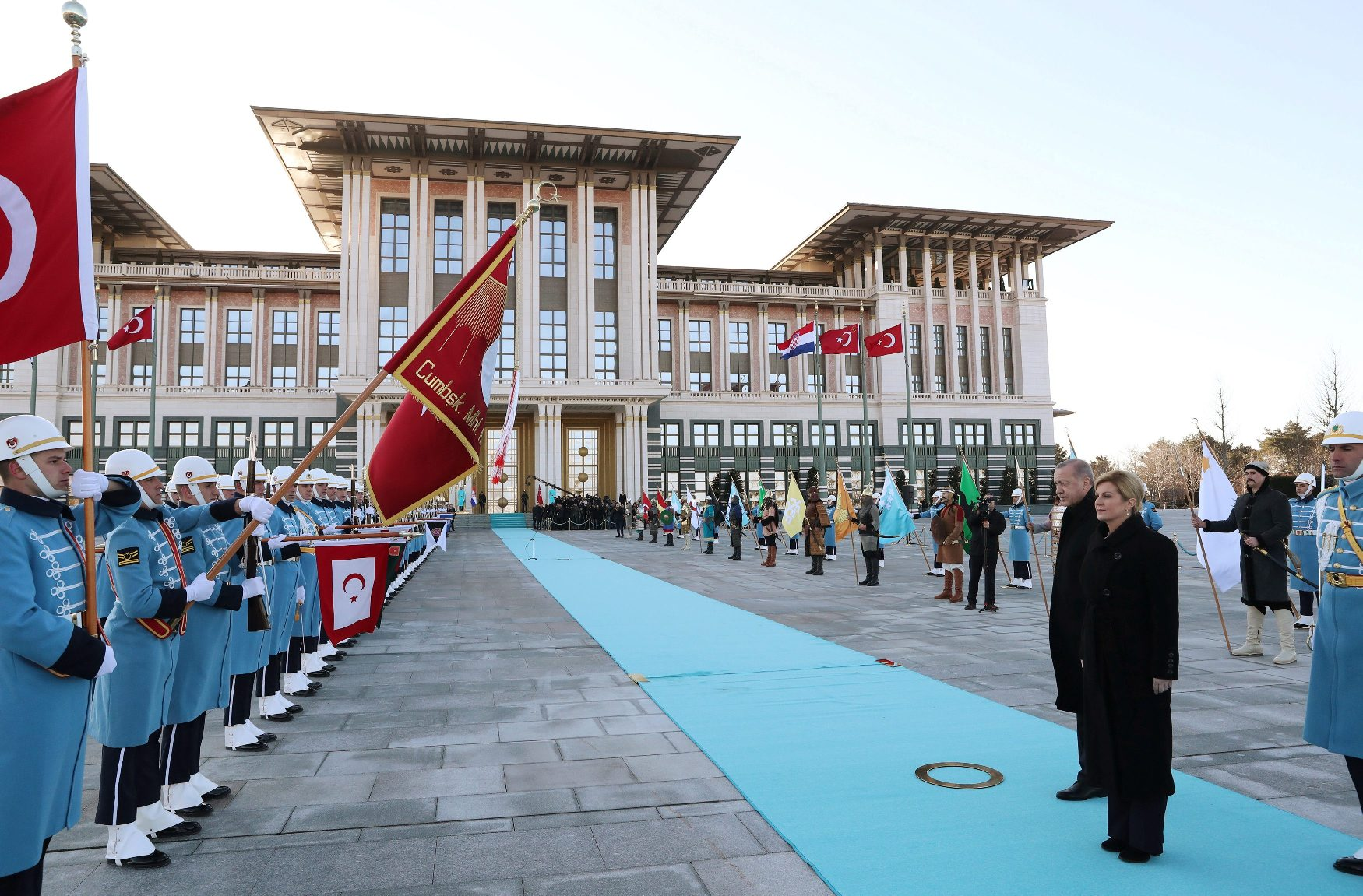 Turkish President Tayyip Erdogan and Croatian President Kolinda Grabar-Kitarovic review a guard of honour during a welcoming ceremony at the Presidential Palace in Ankara, Turkey January 16, 2019. Kayhan Ozer/Presidential Press Office/Handout via REUTERS ATTENTION EDITORS - THIS PICTURE WAS PROVIDED BY A THIRD PARTY. NO RESALES. NO ARCHIVE.