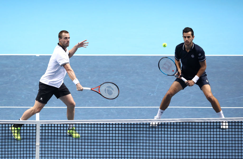 LONDON, ENGLAND - NOVEMBER 14:  Oliver Marach of Austria and partner Mate Pavic of Croatia return the ball during the doubles round robin match against Jack Sock and Mike Bryan of The United States during Day Four of the Nitto ATP Finals at The O2 Arena on November 14, 2018 in London, England.  (Photo by Julian Finney/Getty Images)