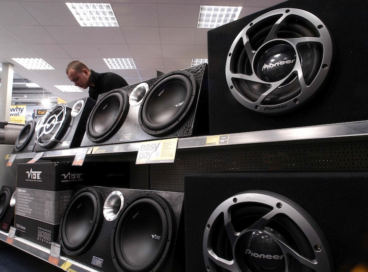 A customer browses in car hi-fi speakers at the Halfords Superstore in west London, Wednesday, May 19, 2004. CVC Capital Partners Ltd. plans to sell shares of U.K. car parts and bicycle retailer Halfords Ltd., becoming at least the 20th buyout firm this year to pursue an initial public offering as stock markets drop. Photographer: David Rose/Bloomberg News.