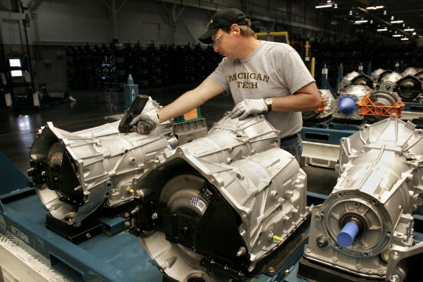 YPSILANTI, MI - MAY 30:  Brian Lindsey of Saline, Michigan, scans new transmissions at the Button Up section of the General Motors Powertrain Ypsilanti Transmission Operations facility May 30, 2006 in Ypsilanti, Michigan. GM will invest 5 million in the facility for additional capacity to produce a family of Hydra-Matic six-speed rear and all-wheel drive automatic transmissions, and will invest an additional  million for vendor tooling, containers, and other locations necessary to support the expanded Ypsilanti operations.  (Photo by Bill Pugliano/Getty Images)