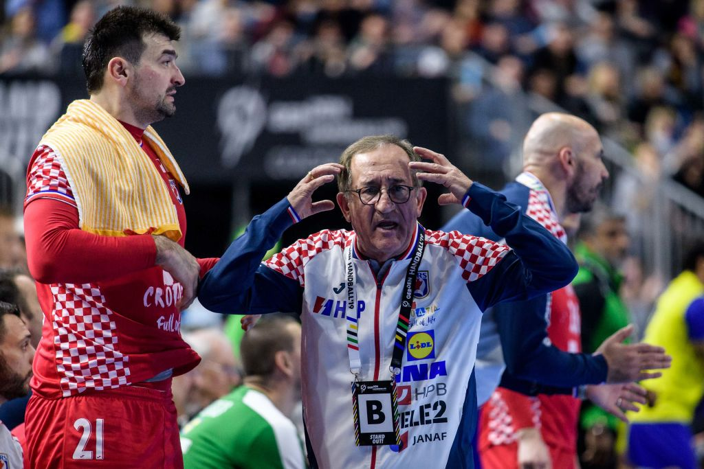 COLOGNE, GERMANY - JANUARY 20: (L-R) Alen Blazevic #21 and Headcoach Lino Cervar of Croatia react during the Main Group 1 match at the 26th IHF Men's World Championship between Brazil and Croatia at the Lanxess Arena on January 20th, 2019 in Cologne, Germany. (Photo by Jörg Schüler/Getty Images)
