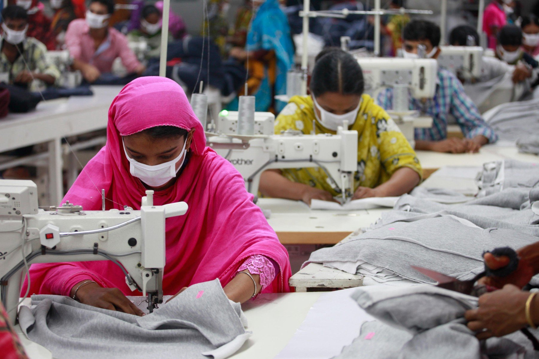 Workers in a ready-made garment factory at Narayanganj on the outskirts of Dhaka, Bangladesh on June 21, 2014. Bangladesh is the second largest apparel exporter in the world after China., Image: 347319405, License: Royalty-free, Restrictions: , Model Release: no, Credit line: Profimedia, Alamy