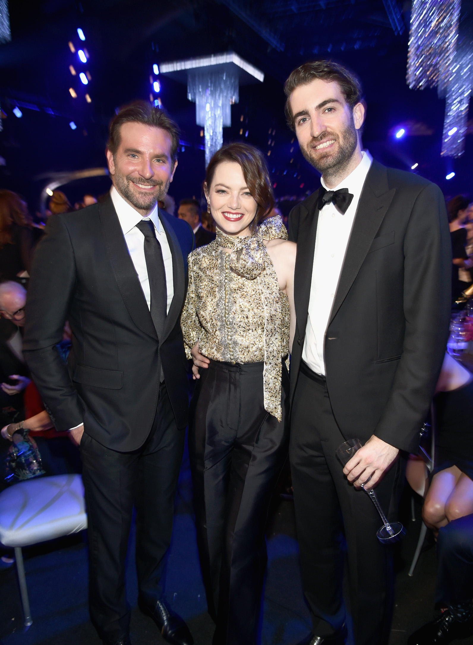 LOS ANGELES, CA - JANUARY 27:  (L-R) Bradley Cooper, Emma Stone, and Dave McCary during the 25th Annual Screen Actors Guild Awards at The Shrine Auditorium on January 27, 2019 in Los Angeles, California. 480595  (Photo by Dimitrios Kambouris/Getty Images for Turner)