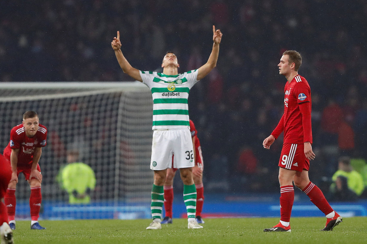 Soccer Football - Scottish League Cup Final - Aberdeen v Celtic - Hampden Park, Glasgow, Britain - December 2, 2018  Celtic's Filip Benkovic celebrates at the end of the match as Aberdeen's James Wilson looks dejected   REUTERS/Russell Cheyne