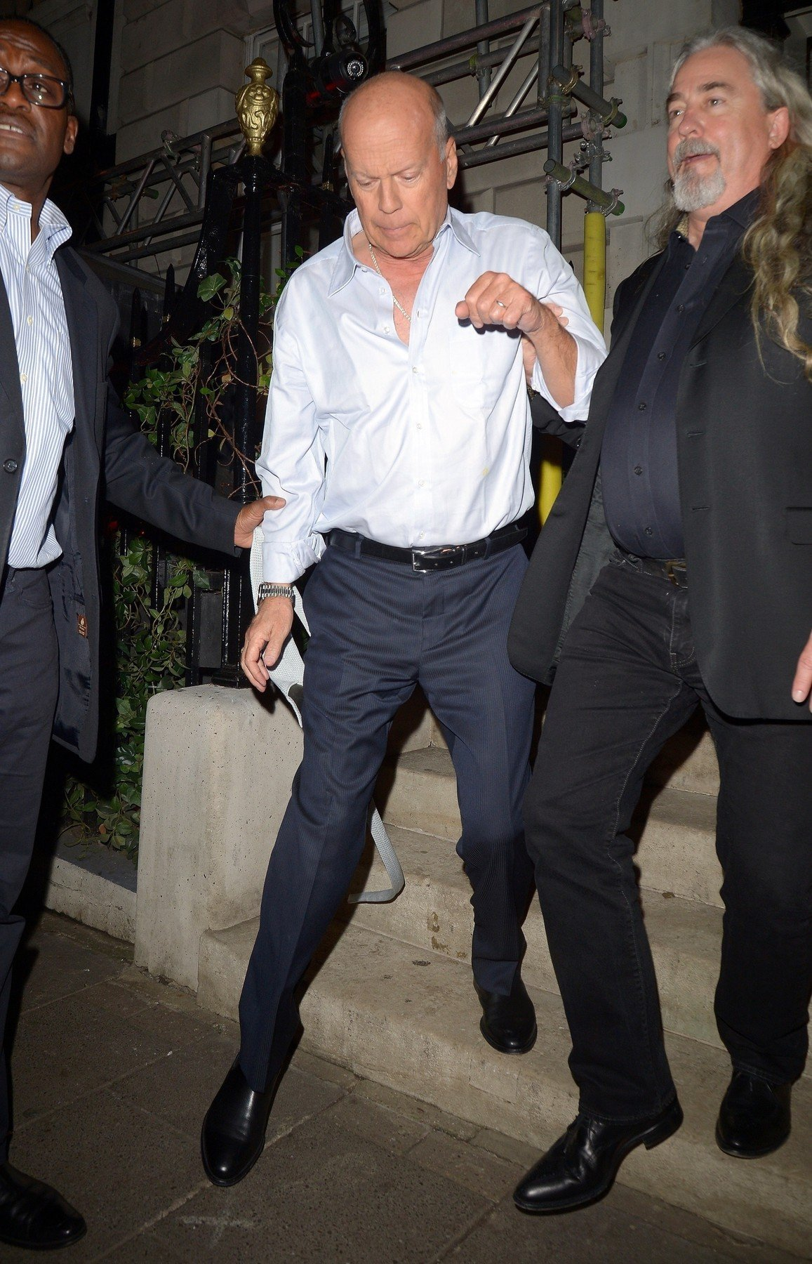 BGUK_1451155 - London, UNITED KINGDOM  - A Very Intoxicated Bruce Willis is seen being helped into his car as he leaves Annabel's Private Members Club  Pictured: Bruce Willis    *UK Clients - Pictures Containing Children Please Pixelate Face Prior To Publication*, Image: 405745688, License: Rights-managed, Restrictions: , Model Release: no, Credit line: Profimedia, Xposurephotos