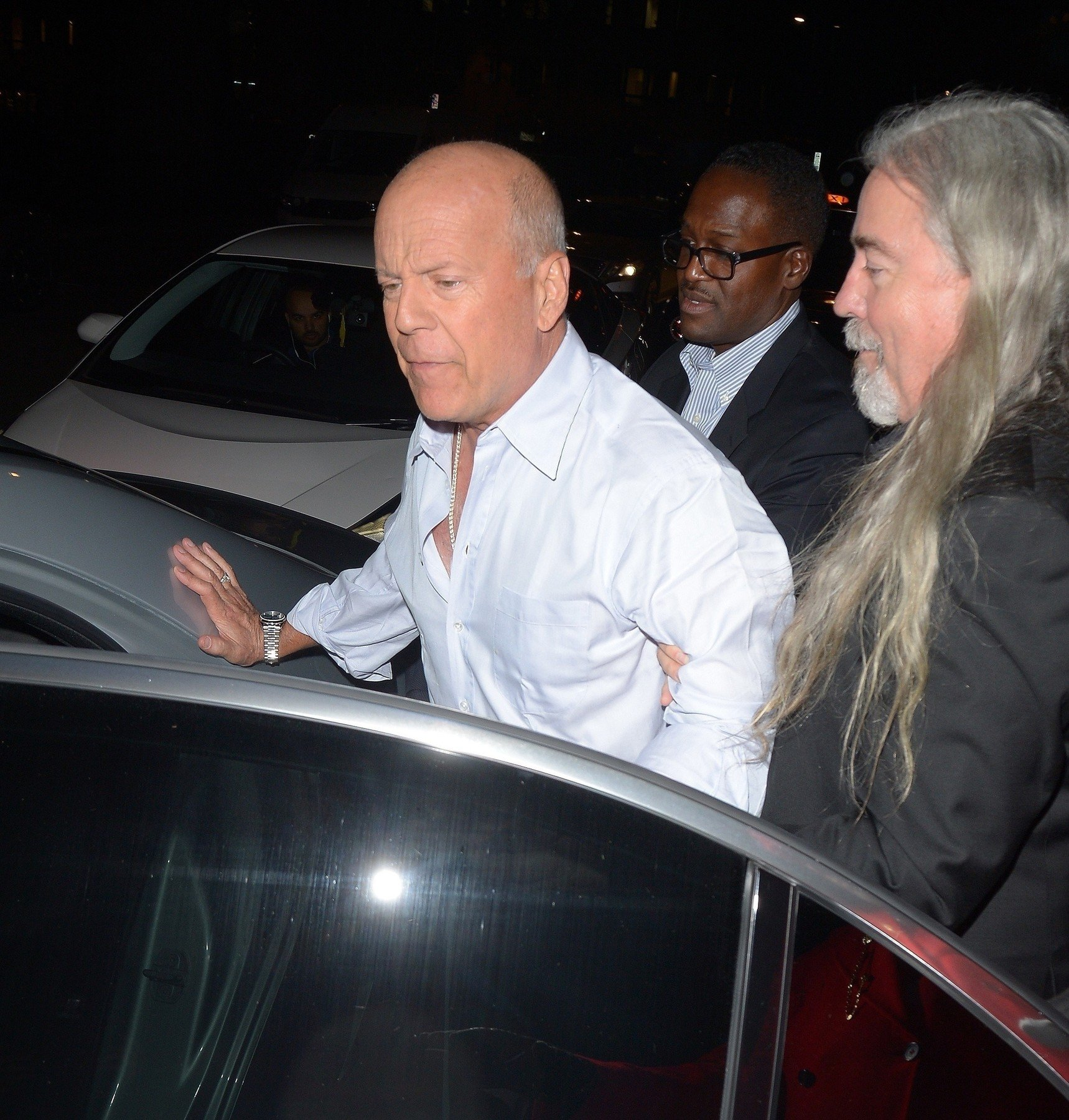 BGUK_1451155 - London, UNITED KINGDOM  - A Very Intoxicated Bruce Willis is seen being helped into his car as he leaves Annabel's Private Members Club  Pictured: Bruce Willis    *UK Clients - Pictures Containing Children Please Pixelate Face Prior To Publication*, Image: 405745945, License: Rights-managed, Restrictions: , Model Release: no, Credit line: Profimedia, Xposurephotos