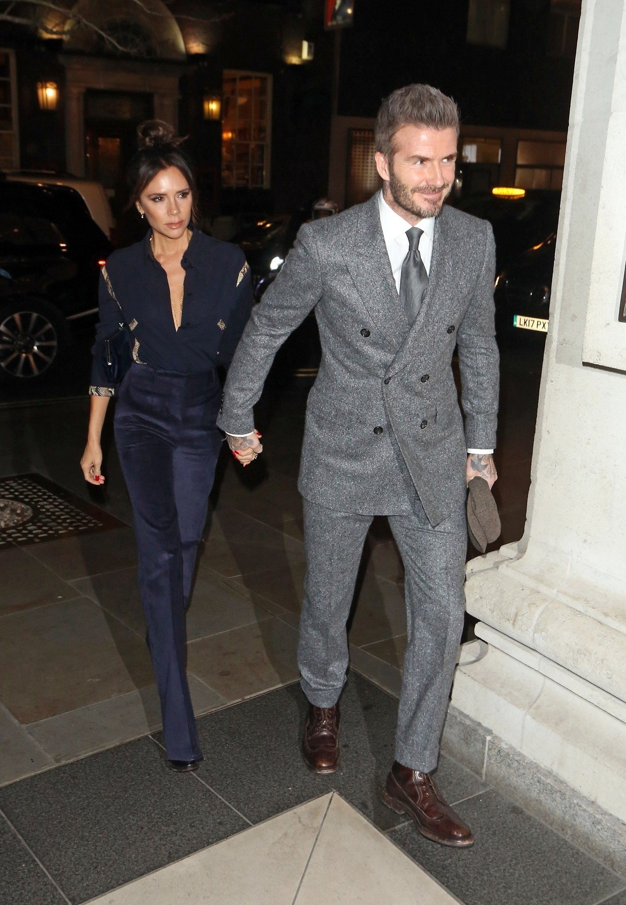 BGUK_1450950 - London, UNITED KINGDOM  - Victoria and David Beckham seen arriving at The Mens GQ Dinner to celebrate London Fashion Week in London. Victoria and David were seen arriving hand in hand at Brasserie of Light restaurant in Selfridges.  Pictured: David Beckham, Victoria Beckham    *UK Clients - Pictures Containing Children Please Pixelate Face Prior To Publication*, Image: 405734429, License: Rights-managed, Restrictions: , Model Release: no, Credit line: Profimedia, Xposurephotos