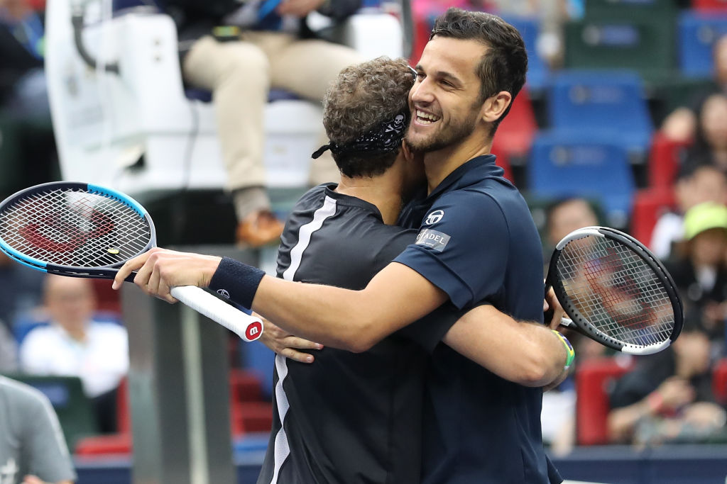 SHANGHAI, CHINA - OCTOBER 13:  Mate Pavic (R) of Croatia and Bruno Soares of Brazil celebrate after winning the Men's doubles final match against Lukasz Kubot of Poland and Marcelo Melo of Brazil on day nine of 2019 Shanghai Rolex Masters at Qi Zhong Tennis Centre on October 13, 2019 in Shanghai, China.  (Photo by Lintao Zhang/Getty Images)