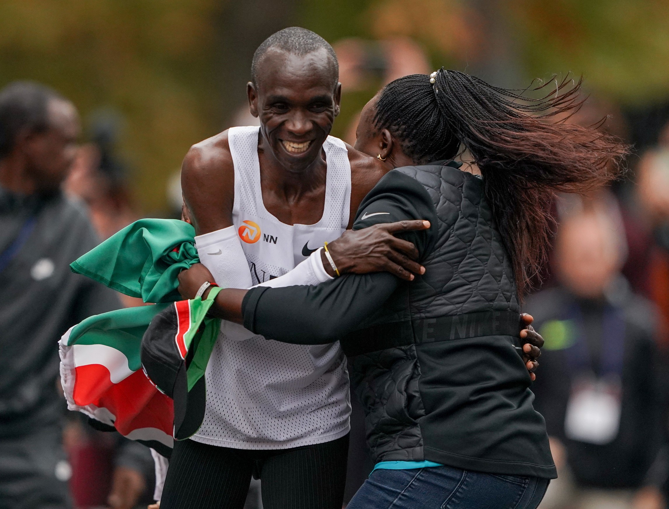 Free for editorial use and archive. Eliud Kipchoge is hugged by his wife Grace Sugutt after he breaks the historic two hour barrier for a marathon. The INEOS 1:59 Challenge, Vienna, Austria. 12 October 2019. Photo: Jed Leicester for The INEOS 1:59 Challenge The INEOS 1:59 Challenge, Image: 476338110, License: Rights-managed, Restrictions: , Model Release: no, Credit line: REX / Shutterstock Editorial / Profimedia