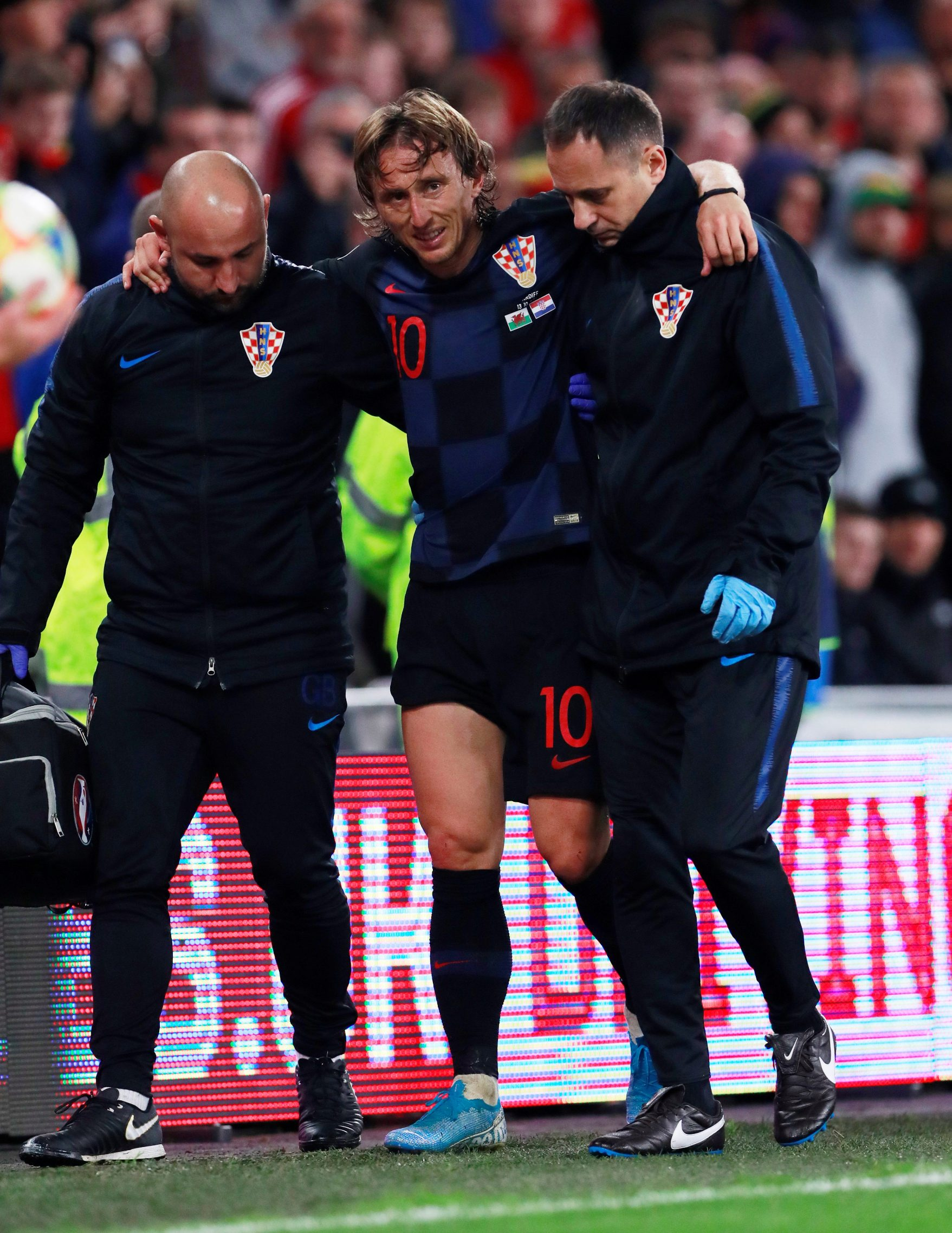 Soccer Football - Euro 2020 Qualifier - Group E - Wales v Croatia - Cardiff City Stadium, Cardiff, Britain - October 13, 2019  Croatia's Luka Modric is helped off the pitch after sustaining an injury             Action Images via Reuters/Andrew Couldridge