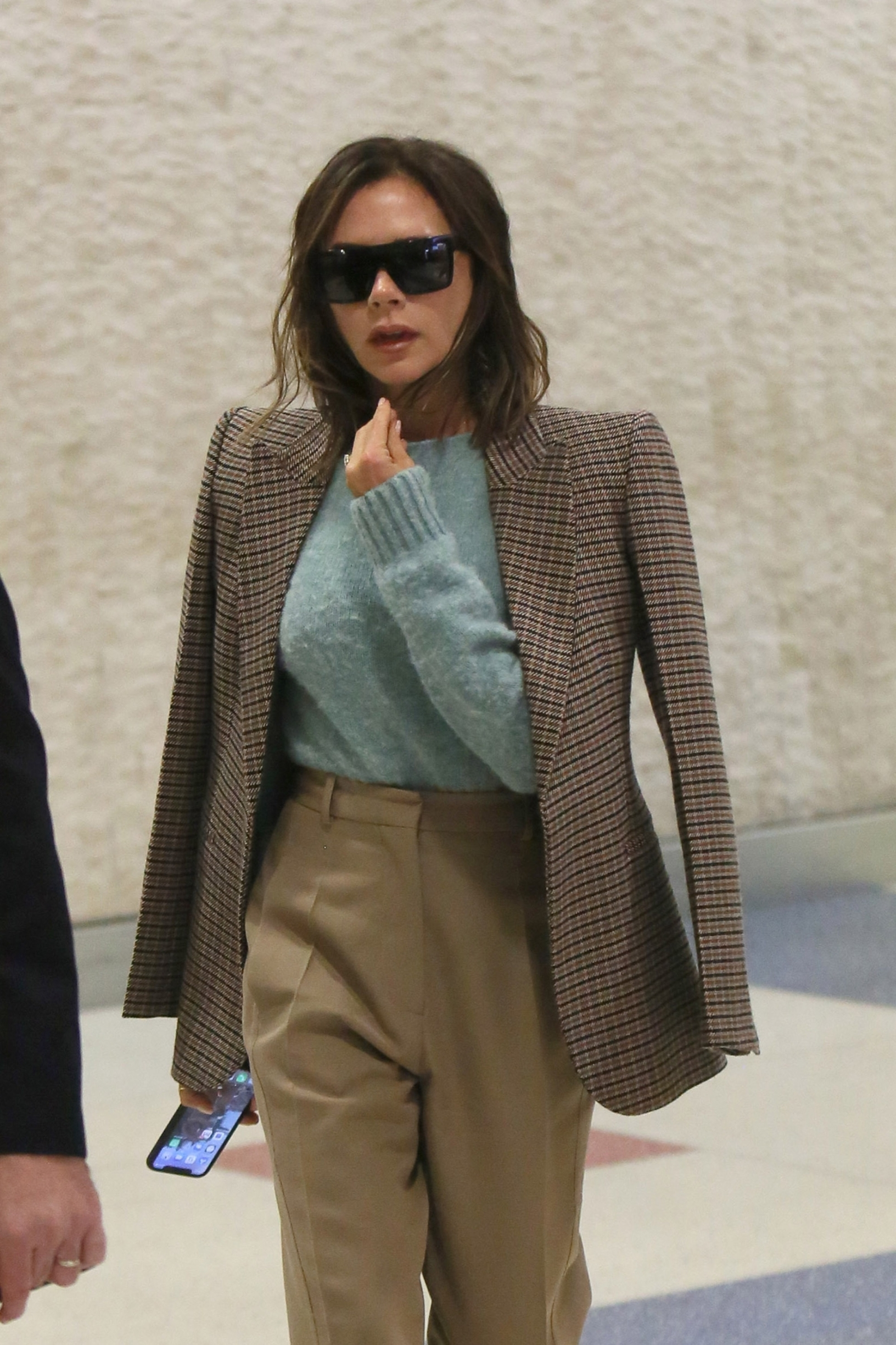 New York city, NY  - Victoria Beckham touches down in New York with a flight at JFK airport, wearing a brown plaid blazer, a green sweater and tan slacks with popping yellow heels.  BACKGRID USA 14 OCTOBER 2019, Image: 476761898, License: Rights-managed, Restrictions: , Model Release: no, Credit line: T.JACKSON / BACKGRID / Backgrid USA / Profimedia