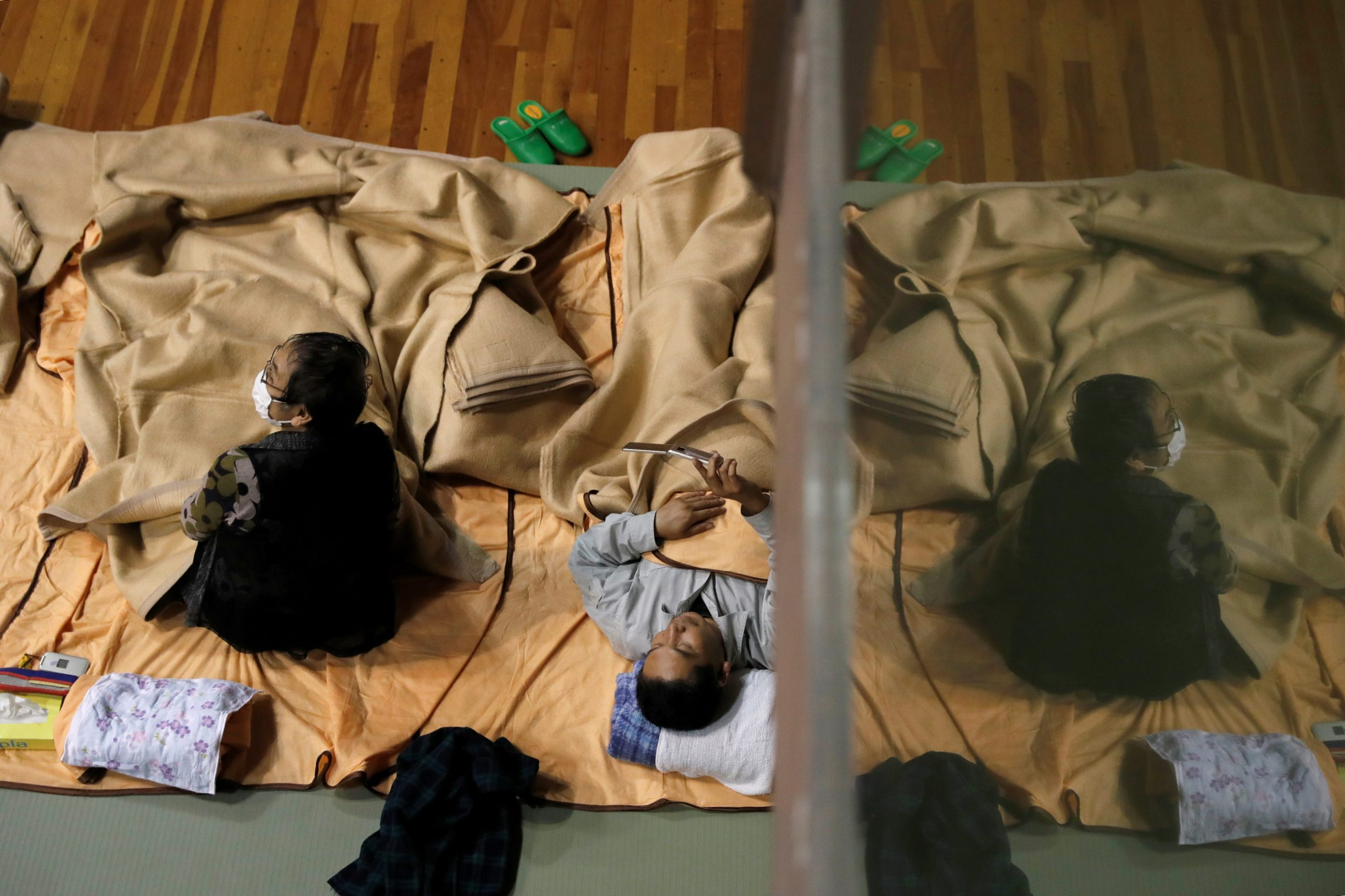 People rest in the evacuation centre for affected by the flood after Typhoon Hagibis in Nagano, Nagano Prefecture, Japan, October 13, 2019. REUTERS/Kim Kyung-Hoon