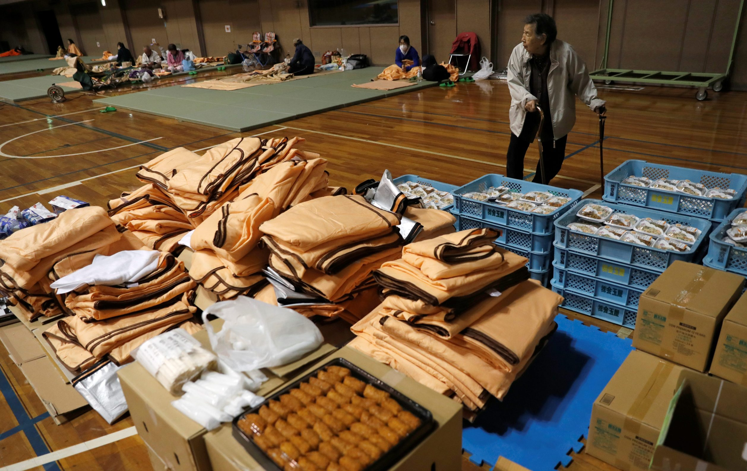 A person walks past goods provided in the evacuation centre for affected by the flood after Typhoon Hagibis in Nagano, Nagano Prefecture, Japan, October 13, 2019. REUTERS/Kim Kyung-Hoon