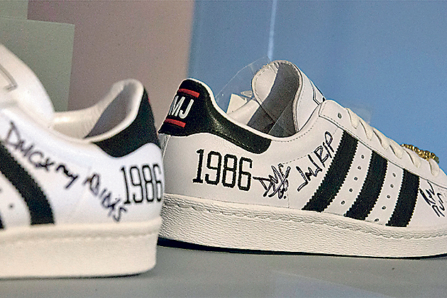 A pair of Adidas x Run-DMC 25th Anniversary Superstar are displayed during