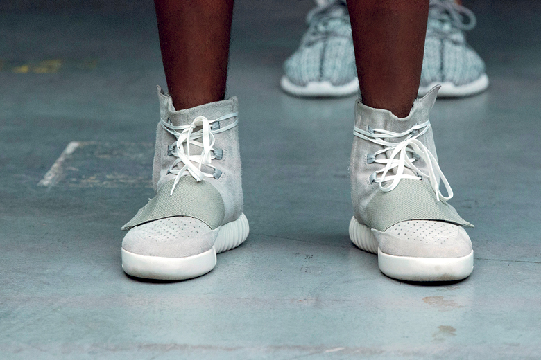 A model wears a pair of Adidas Yeezy 750 Boost shoes designed by Kanye West as part of his Fall/Winter 2015 partnership line with Adidas at New York Fashion Week, U.S. February 12, 2015. Picture taken February 12, 2015. REUTERS/Lucas Jackson/File photo - D1BETMROZEAA