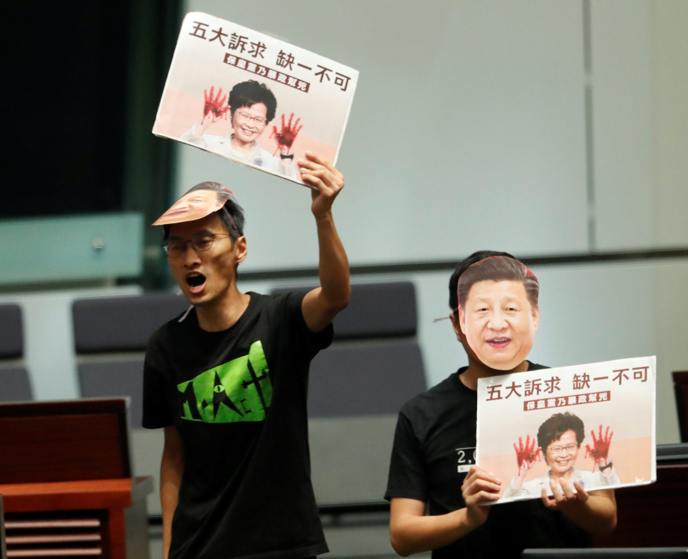 Lawmakers jeer as Hong Kong Chief Executive Carrie Lam attempts to deliver her annual policy address, at the Legislative Council in Hong Kong, China, October 16, 2019. REUTERS/Kim Kyung-Hoon