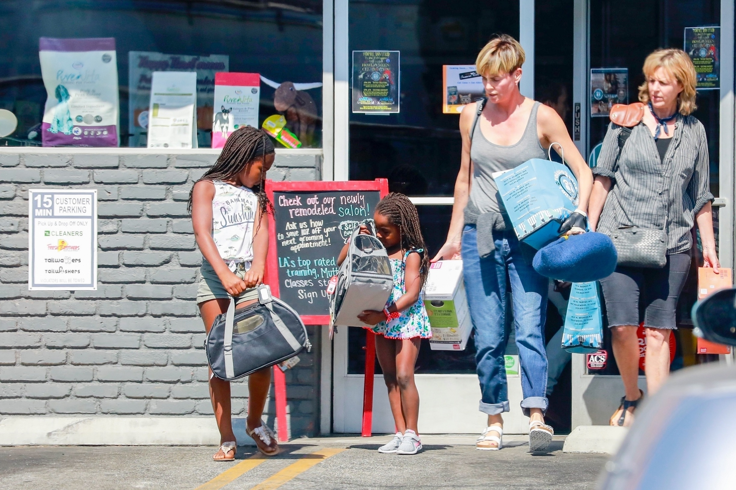 Los Feliz, CA  - *EXCLUSIVE*  - Charlize Theron takes her kids out to get new pets. The actress left the pet shop with her hands full of pet accessories and food while her daughters looked happy carrying their new furry friends.  *UK Clients - Pictures Containing Children Please Pixelate Face Prior To Publication*, Image: 475309176, License: Rights-managed, Restrictions: , Model Release: no, Credit line: Terma,SL / BACKGRID / Backgrid USA / Profimedia