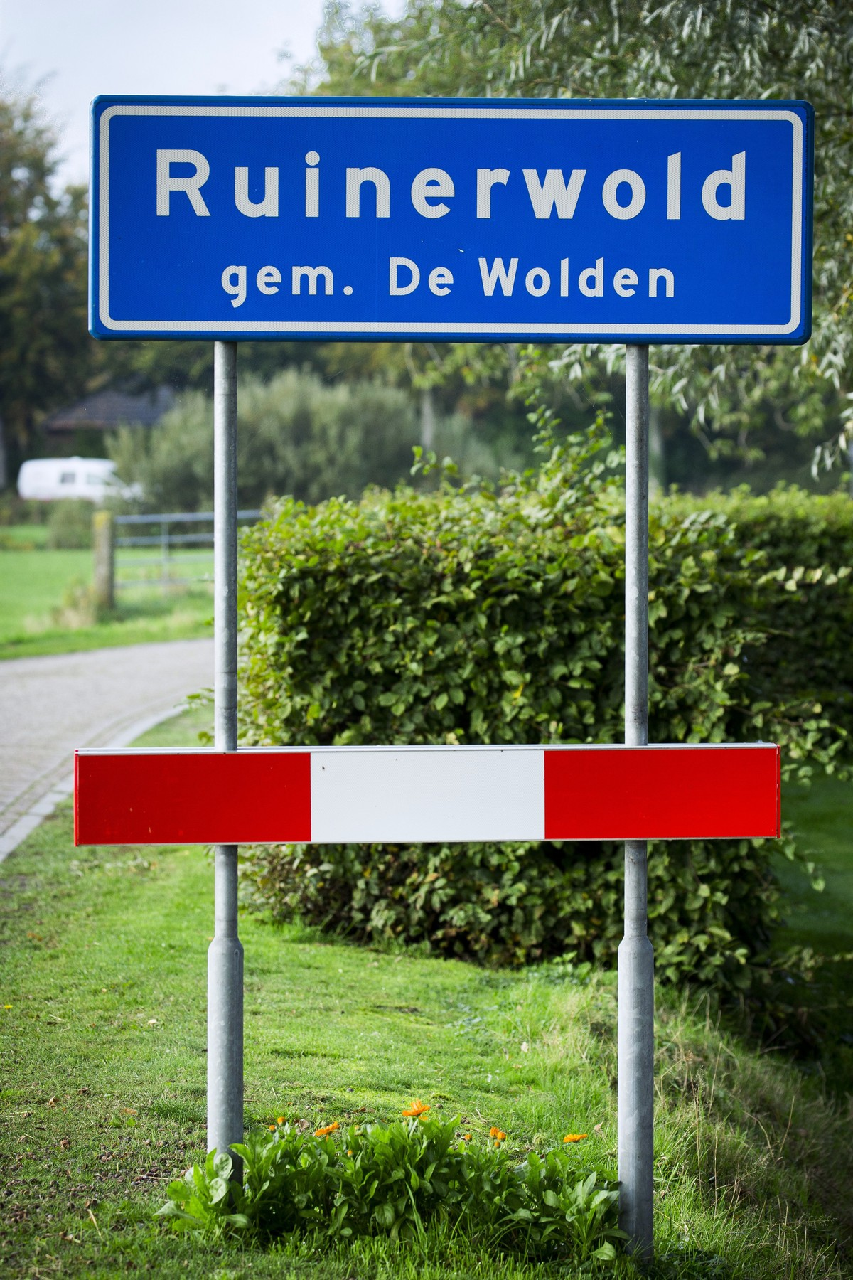 A picture taken on October 16, 2019 shows the road sign of the village of Ruinerwold, where in a remote area of northern Netherlands' province of Drenthe, in a farmhouse, Dutch police discovered a hidden staircase behind a cupboard leading to a cellar where a man and five others believed to be his children aged between 18 and 25 were hidden and reportedly spent years
