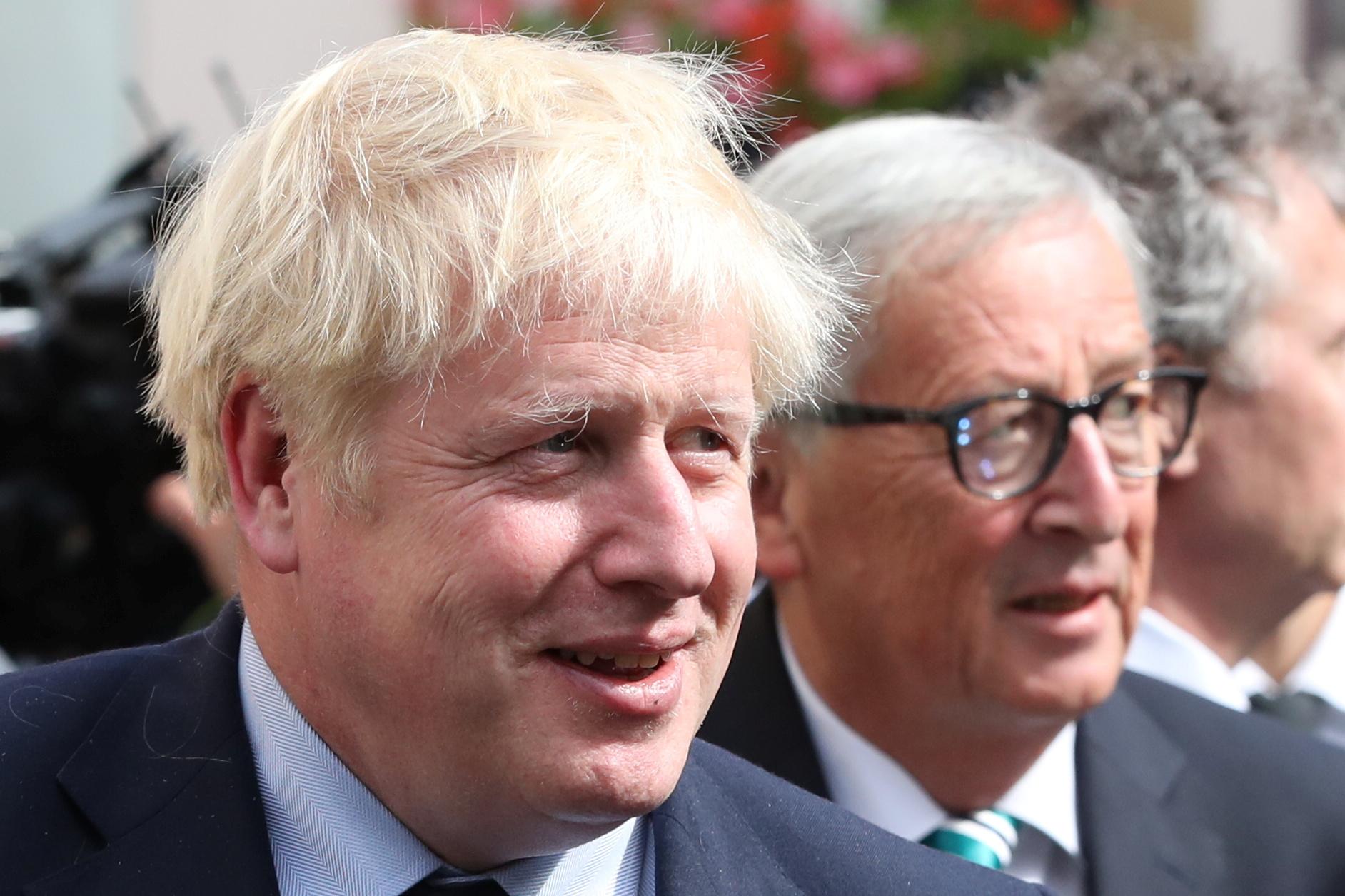 Britanski premijer Boris Johnson (lijevo) i predsjednik Europske komisije Jean-Claude Juncker
