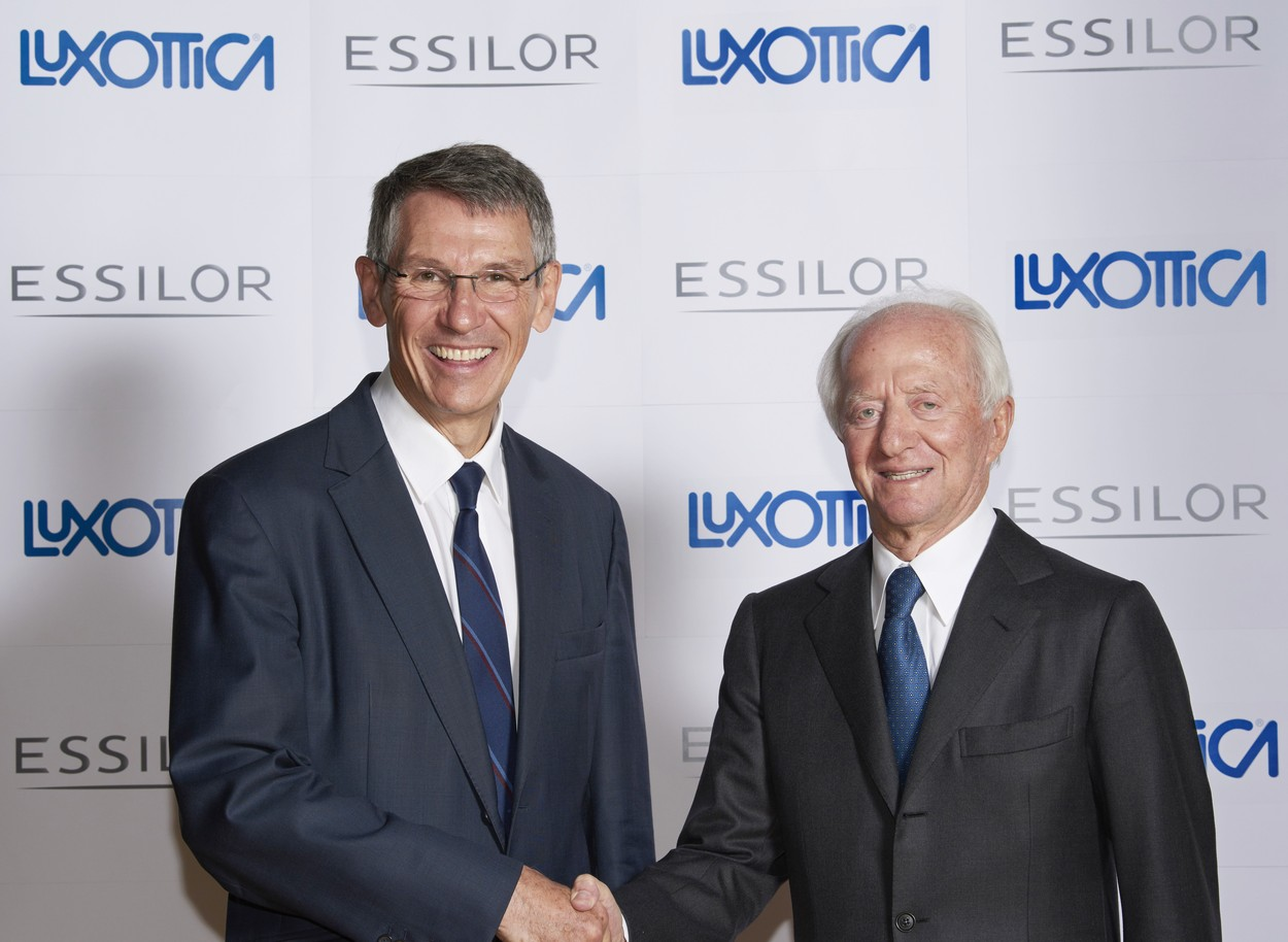 A handout photo taken on January 16, 2017 and released by Essilor shows Founder and Chairperson of Italian eyeglass producer Luxottica Leonardo Del Vecchio (R) shaking hands with CEO of French lens maker Essilor Hubert Sagnieres in Paris. French lensmaker Essilor has agreed to buy Italy's Luxottica, maker of Ray-Ban sunglasses, in a bid to create a new global giant in the sector, the two groups announced on January 16., Image: 311065292, License: Rights-managed, Restrictions: RESTRICTED TO EDITORIAL USE - MANDATORY CREDIT