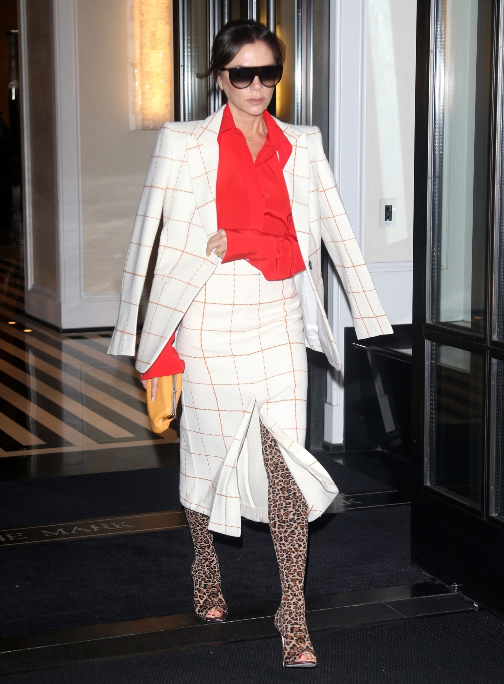 New York, NY  - Fashion Icon and Former Spice Girl, Victoria Beckham causes the paparazzi to go crazy as she is seen leaving a building heading to her car in the Upper Eastside of New York. Victoria looks like a true businesswoman as she dons a gingham suit dress and leopard shoes.  *UK Clients - Pictures Containing Children Please Pixelate Face Prior To Publication*, Image: 477434777, License: Rights-managed, Restrictions: , Model Release: no, Credit line: DARA / BACKGRID / Backgrid USA / Profimedia