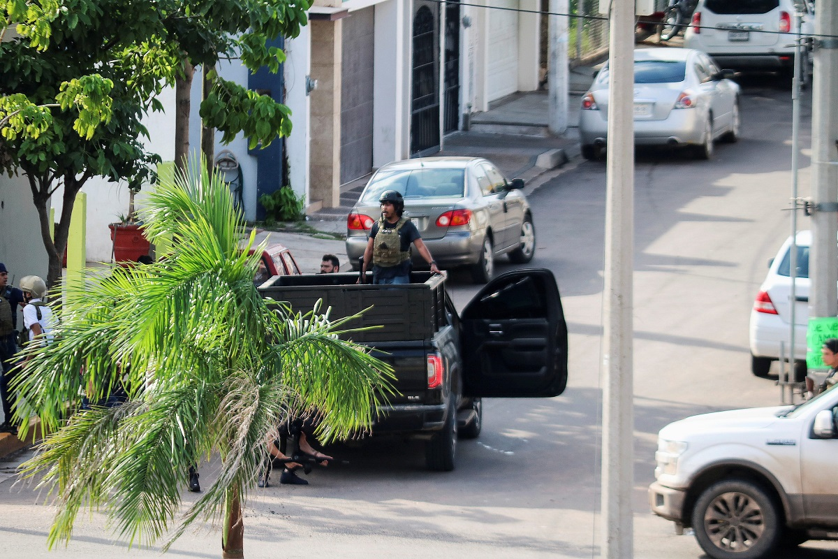 Cartel gunmen are seen on a truck during clashes with federal forces following the detention of Ovidio Guzman, son of drug kingpin Joaquin