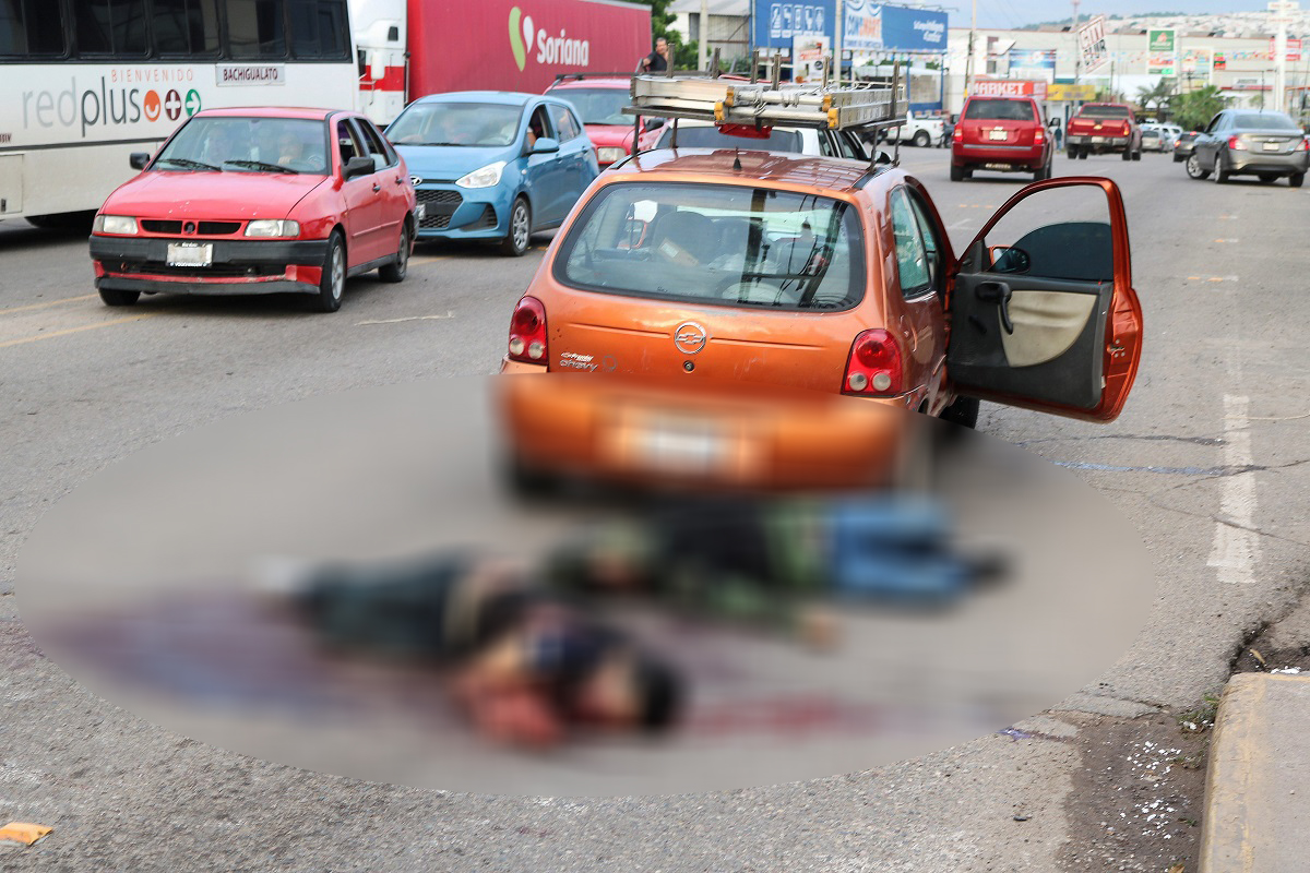 ATTENTION EDITORS - SENSITIVE MATERIAL. THIS IMAGE MAY OFFEND OR DISTURB        Dead bodies lie next to a car during clashes between Cartel gunmen and federal forces following the detention of Ovidio Guzman, son of drug kingpin Joaquin