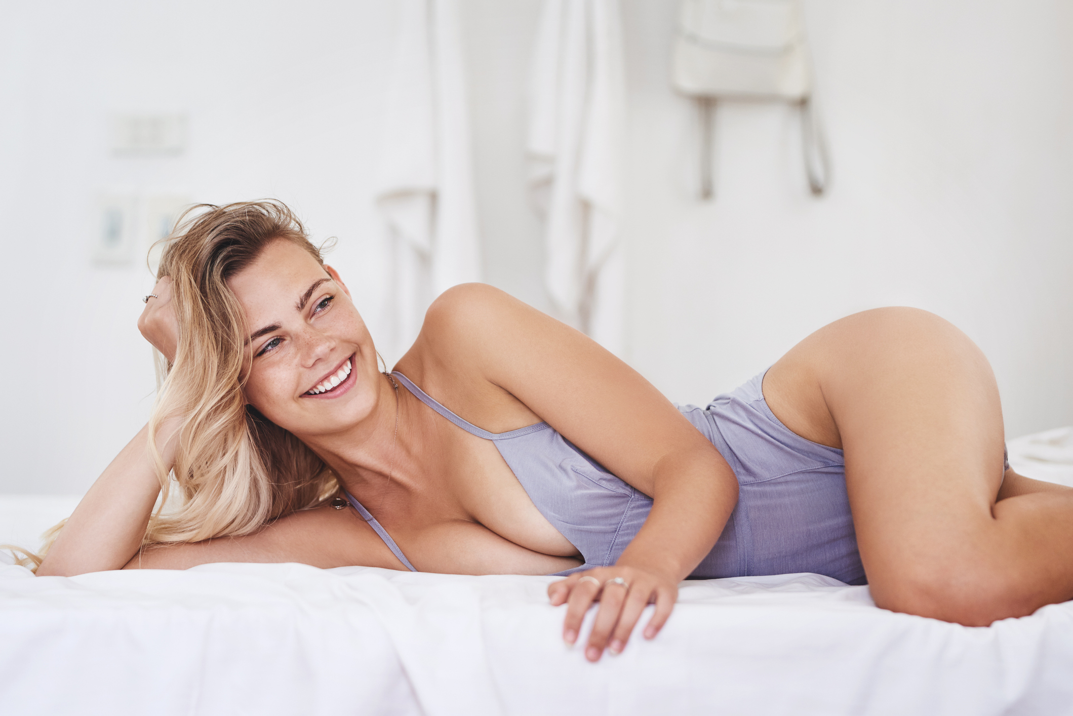 Cropped shot of an attractive young woman relaxing on her bed at home