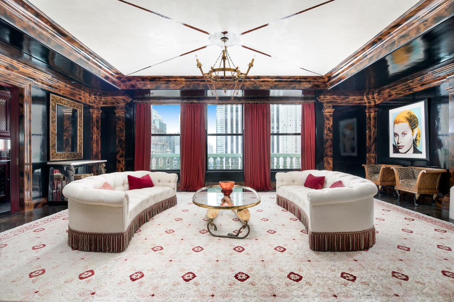 "Fashion designer Tommy Hilfiger has finally sold his extravagant New York-based penthouse apartment after knocking nearly FIFTY million dollars off the asking price!  The four-bedroom home has reportedly sold for a reported .35 million. It originally went up for sale for a staggering  million.  Insiders claim the home's exquisite furniture is also be included in the deal.  Hilfiger bought the corner duplex for .5 million in 2008, and then tried to flip it for  million a few months later.  The designer and his wife Dee Ocleepo then spent around  million on renovations. In 2013, the 6,050-square-foot home went back on the market for an eye-popping  million.  The price dropped to  million in March 2015 and then  million before dropping to .9 million in April 2016. It was then reduced to  million in September 2017 At one point, real estate insiders claim the apartment was ""unsellable.""  The art-filled corner penthouse features Central Park and Fifth Avenue views and 10- to 35-foot ceiling heights.  The upper level, reached by a spiral staircase, includes a decorative fireplace in the master suite and a terrace that overlooks the park.   The chef's kitchen sports sleek black cabinetry, an office/library space is also clad in black and the three additional bedrooms come decked out, in part, with nautical and rock n' roll themes.  It features marble-clad rooms, vintage limestone fireplaces from England and a domed room that features a custom-designed ""Elouise"" mural designed by the children book's illustrator Hilary Knight.  The couple decided to sell up as they are rarely in the New York because they spend most of their time in estate in Greenwich, Connecticut., Image: 473677501, License: Rights-managed, Restrictions: , Model Release: no, Credit line: IMP Features / IMP Features / Profimedia"