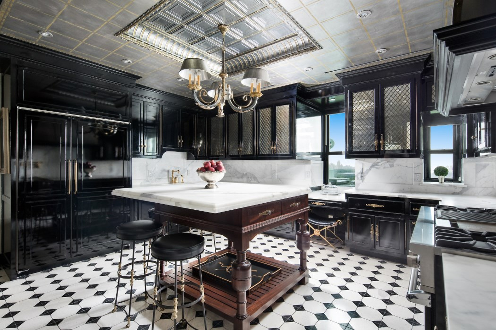 "Fashion designer Tommy Hilfiger has finally sold his extravagant New York-based penthouse apartment after knocking nearly FIFTY million dollars off the asking price!  The four-bedroom home has reportedly sold for a reported .35 million. It originally went up for sale for a staggering  million.  Insiders claim the home's exquisite furniture is also be included in the deal.  Hilfiger bought the corner duplex for .5 million in 2008, and then tried to flip it for  million a few months later.  The designer and his wife Dee Ocleepo then spent around  million on renovations. In 2013, the 6,050-square-foot home went back on the market for an eye-popping  million.  The price dropped to  million in March 2015 and then  million before dropping to .9 million in April 2016. It was then reduced to  million in September 2017 At one point, real estate insiders claim the apartment was ""unsellable.""  The art-filled corner penthouse features Central Park and Fifth Avenue views and 10- to 35-foot ceiling heights.  The upper level, reached by a spiral staircase, includes a decorative fireplace in the master suite and a terrace that overlooks the park.   The chef's kitchen sports sleek black cabinetry, an office/library space is also clad in black and the three additional bedrooms come decked out, in part, with nautical and rock n' roll themes.  It features marble-clad rooms, vintage limestone fireplaces from England and a domed room that features a custom-designed ""Elouise"" mural designed by the children book's illustrator Hilary Knight.  The couple decided to sell up as they are rarely in the New York because they spend most of their time in estate in Greenwich, Connecticut., Image: 473677533, License: Rights-managed, Restrictions: , Model Release: no, Credit line: IMP Features / IMP Features / Profimedia"