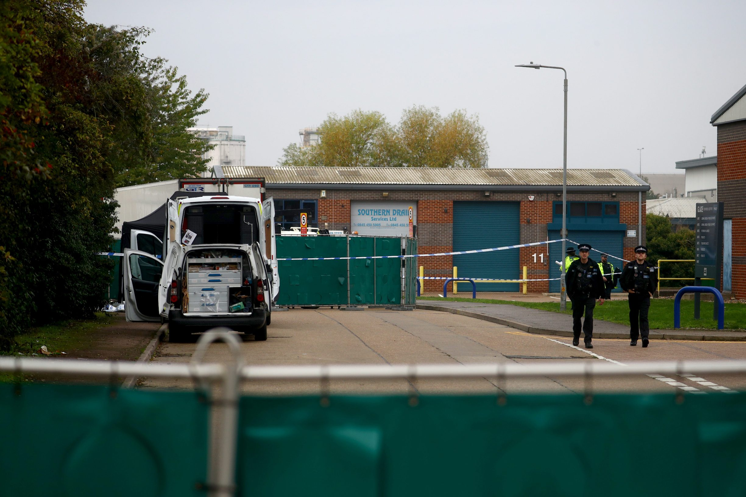 Police officers are seen at the scene where bodies were discovered in a lorry container, in Grays, Essex, Britain October 23, 2019.  REUTERS/Hannah McKay
