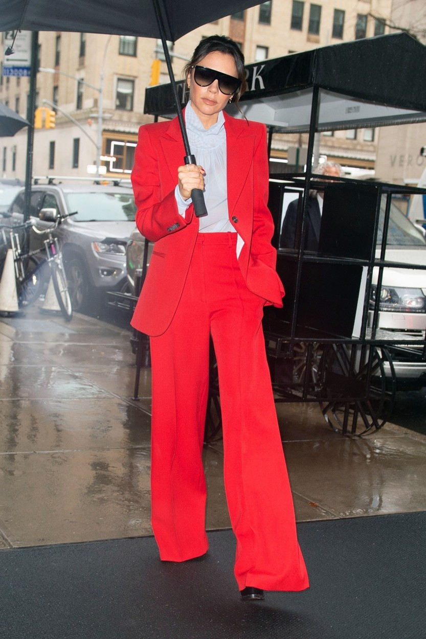 """New York, NY  - Fashion designer and former Spice Girl Victoria Beckham shines brightly in a stylish red suit while escaping back to her hotel rainy in New York. Victoria recently opened up about her decision not to join bandmates Geri Horner, Emma Bunton, Mel B and Melanie Chisolm on the upcoming Spice Girls reunion tour saying, """"I'm sure when they are on stage, a part of me will feel a bit left out, because a part of me will always be a Spice Girl.""""  Pictured: Victoria Beckham    *UK Clients - Pictures Containing Children Please Pixelate Face Prior To Publication*, Image: 410083496, License: Rights-managed, Restrictions: , Model Release: no, Credit line: BACKGRID / Backgrid USA / Profimedia"""